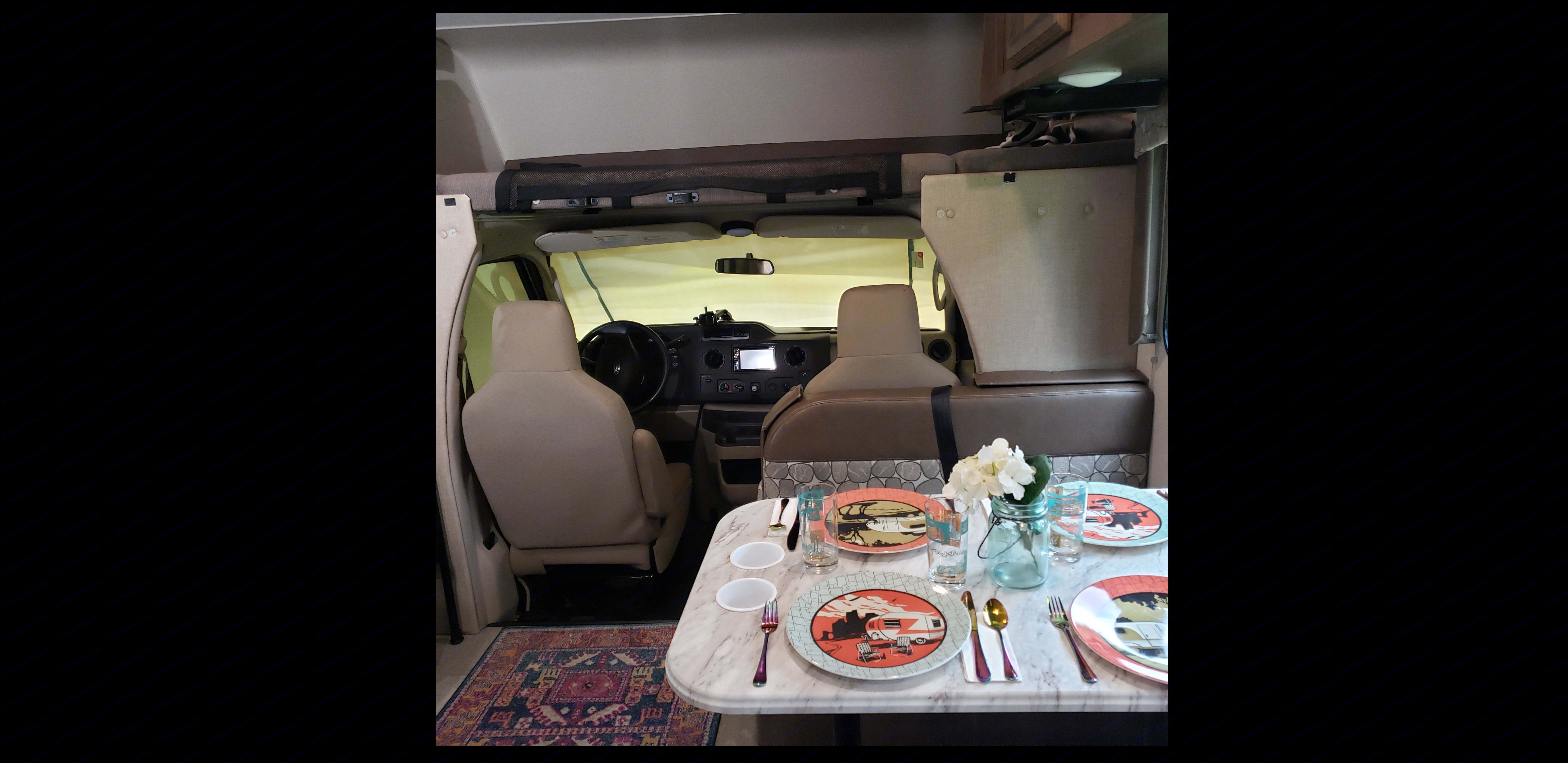 Looking forward to cockpit from entryway. The overhead bunk is 8 foot long and takes king size bedding (included).. Coachmen Freelander BH31 2019