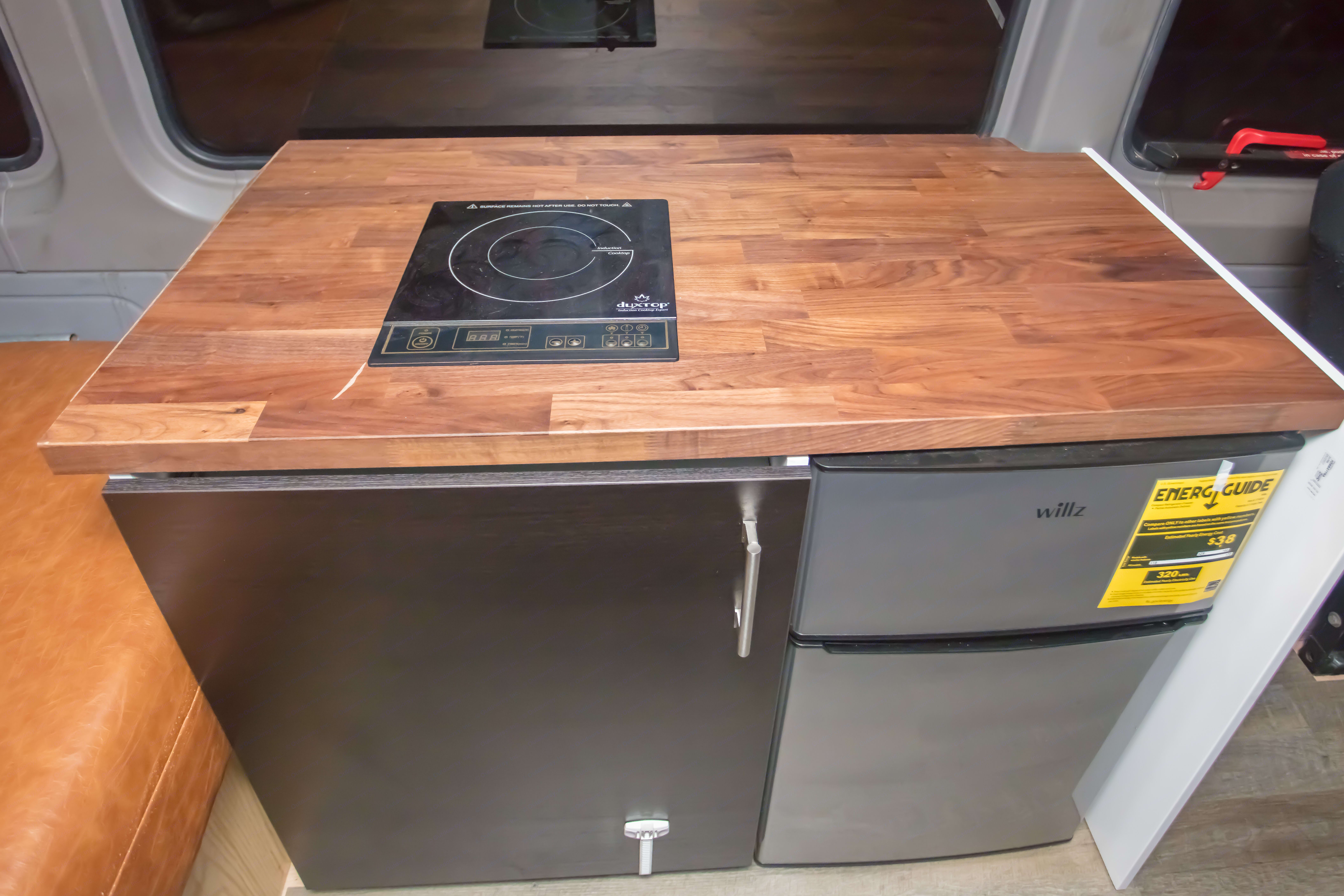 Walnut Butcherblock countertop with safe and efficient 1800W induction stove. Also includes 2 door refrigerator and Microwave. Mercedes-Benz Sprinter 170 EXT 3500 2014