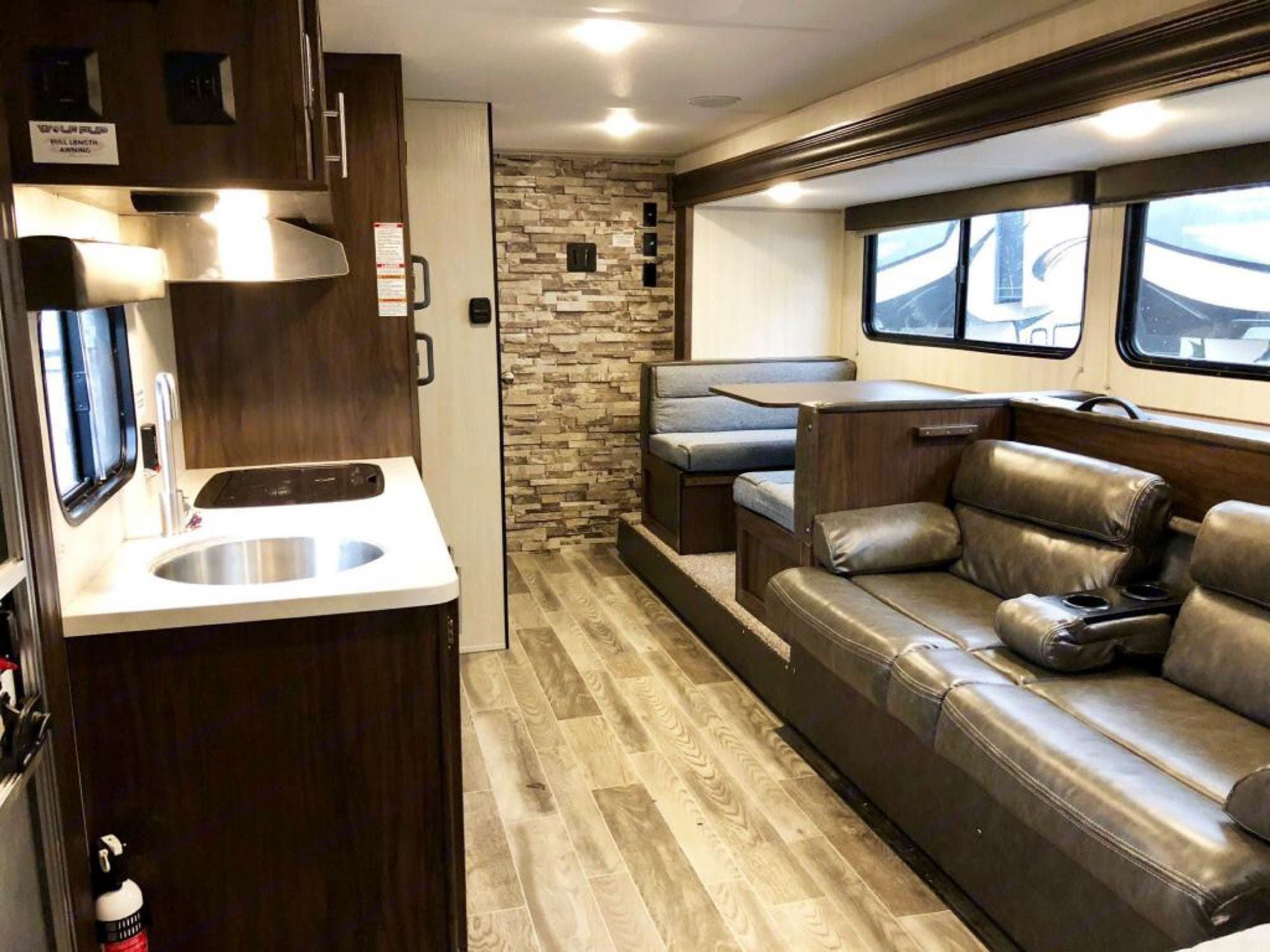 The slideout gives this camper room for several people to move around in. . Forest River Wolf Pup 2019
