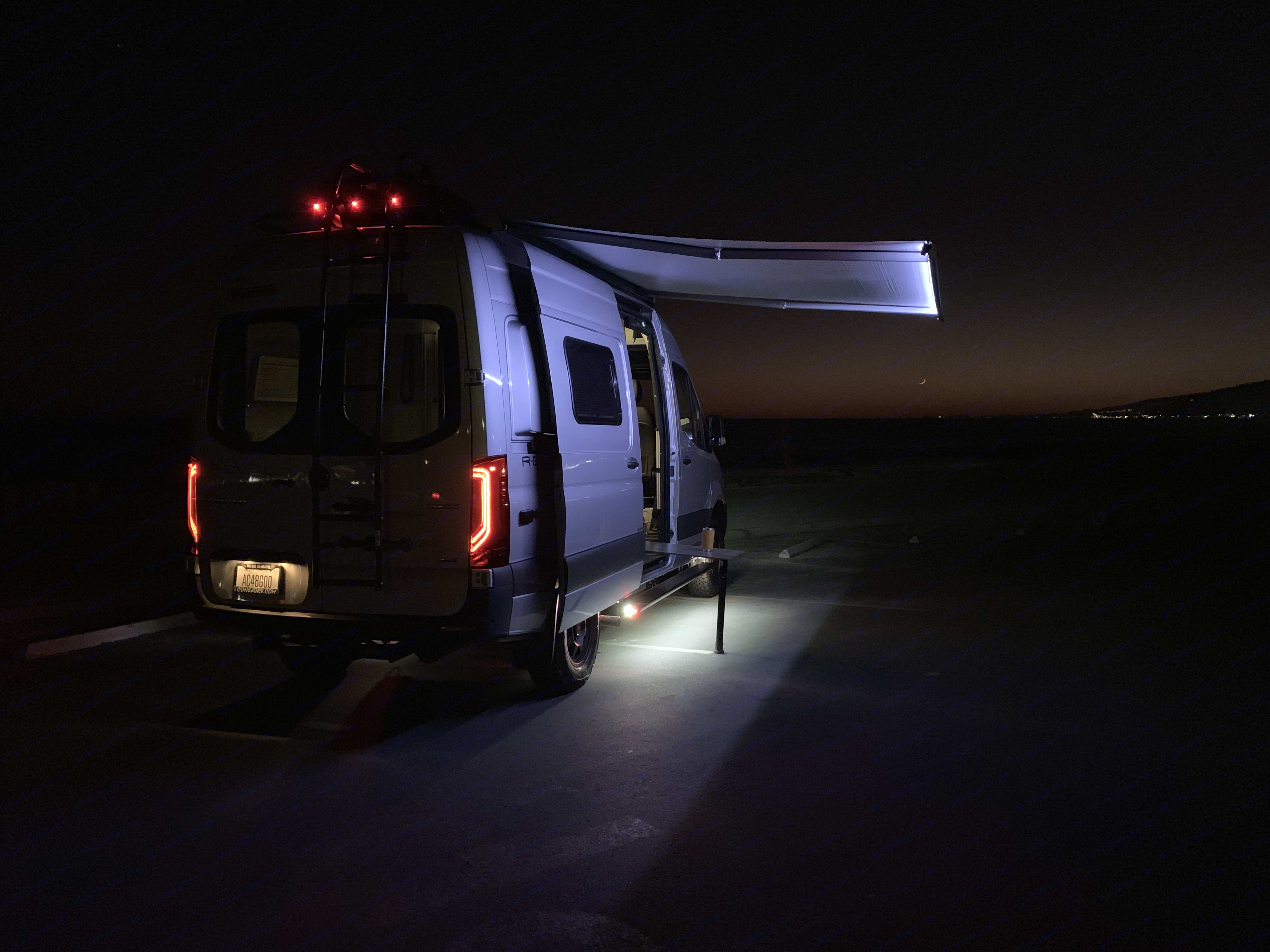 Campsite is lit up.. Winnebago Revel 4x4 2020