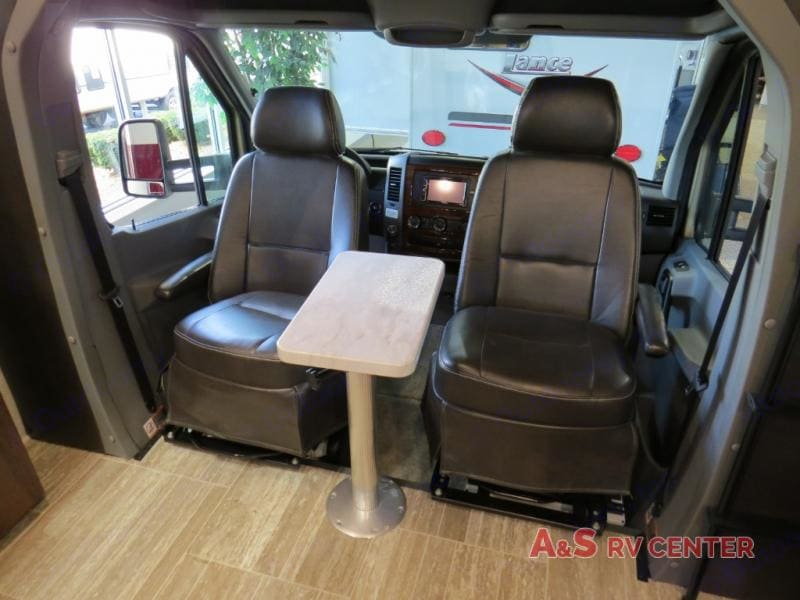 Captain's Chairs swivel 180-degrees to create living room seating. ForestRiver Forester 2019
