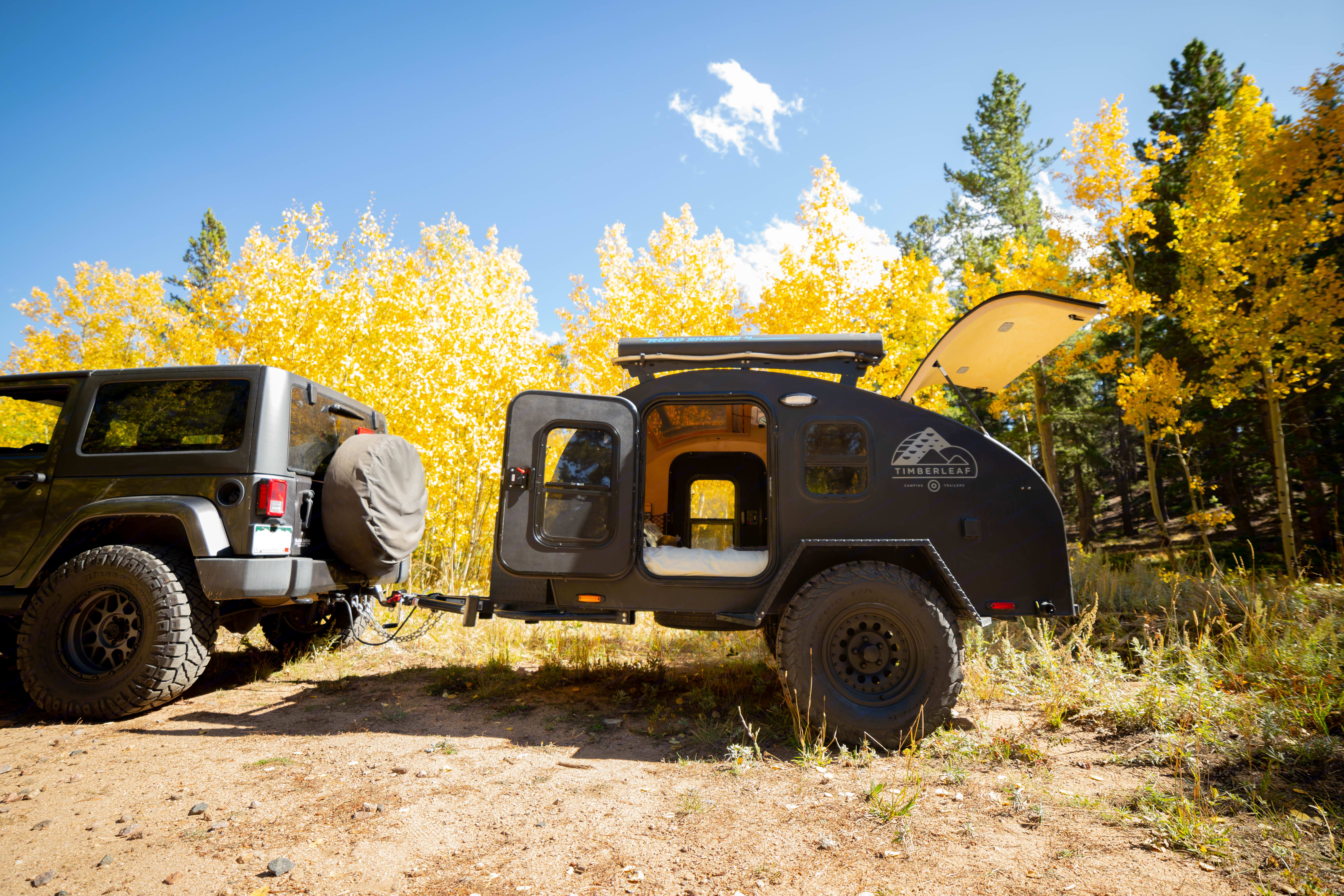 """Timon is the ultimate adventure partner, going anywhere you'd want to go and providing a safe and comfortable place to come back to after a day exploring. With 35"""" tires and a lift, there is plenty of clearance to cover most of Colorado's less traveled areas. At only 1400 lbs, most cars have the ability to tow this trailer to wherever your heart desires.. Timberleaf Pika 2019"""