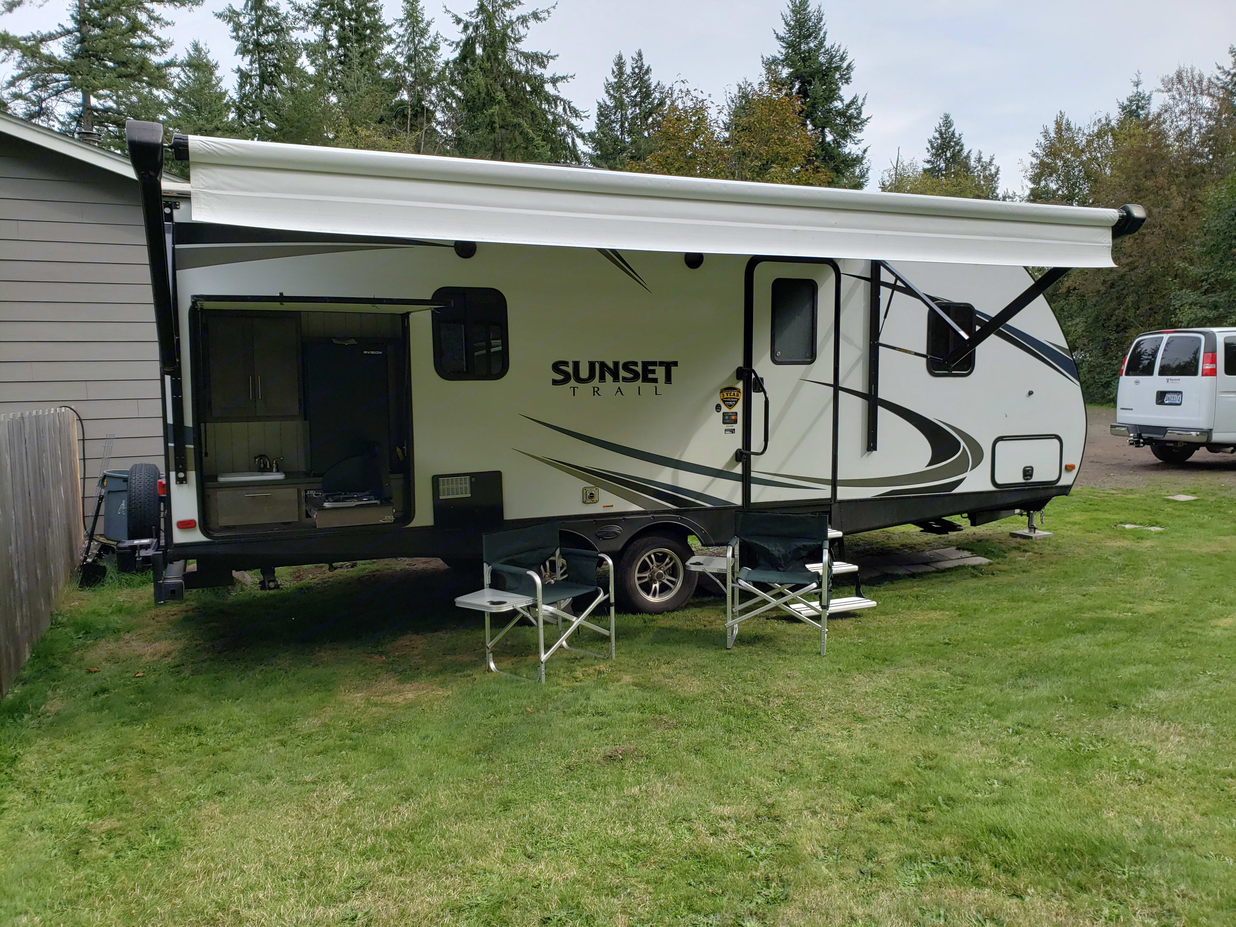 Awning extended with out door stove and refridgerator. Forest River Sunset Trail 2018