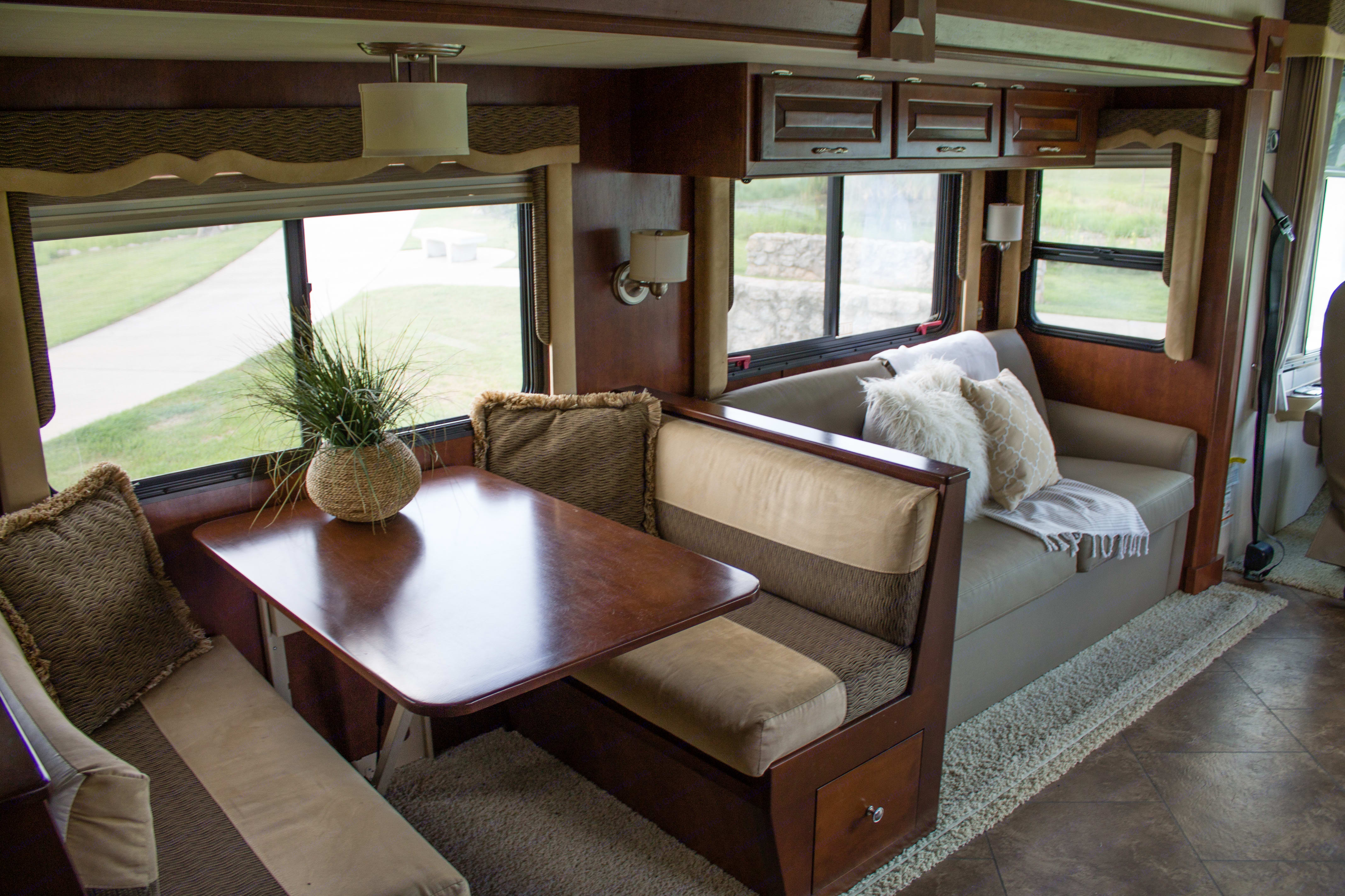 This sofa pulls out into a full size bed and the dinette converts to another bed.. Newmar Bay Star 2012