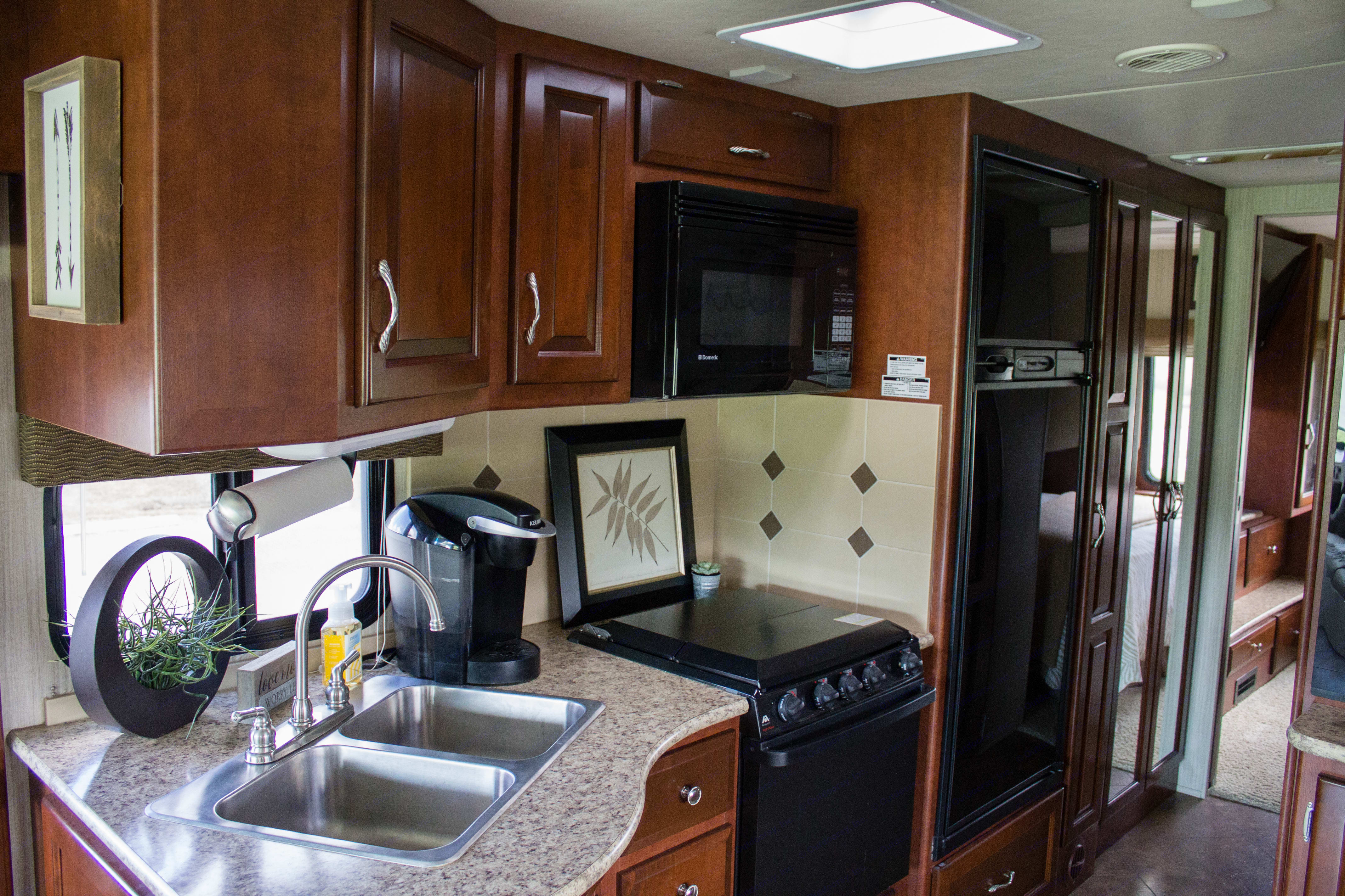 Lots of storage space in the kitchen complete with a keurig and dual-sided sink.. Newmar Bay Star 2012