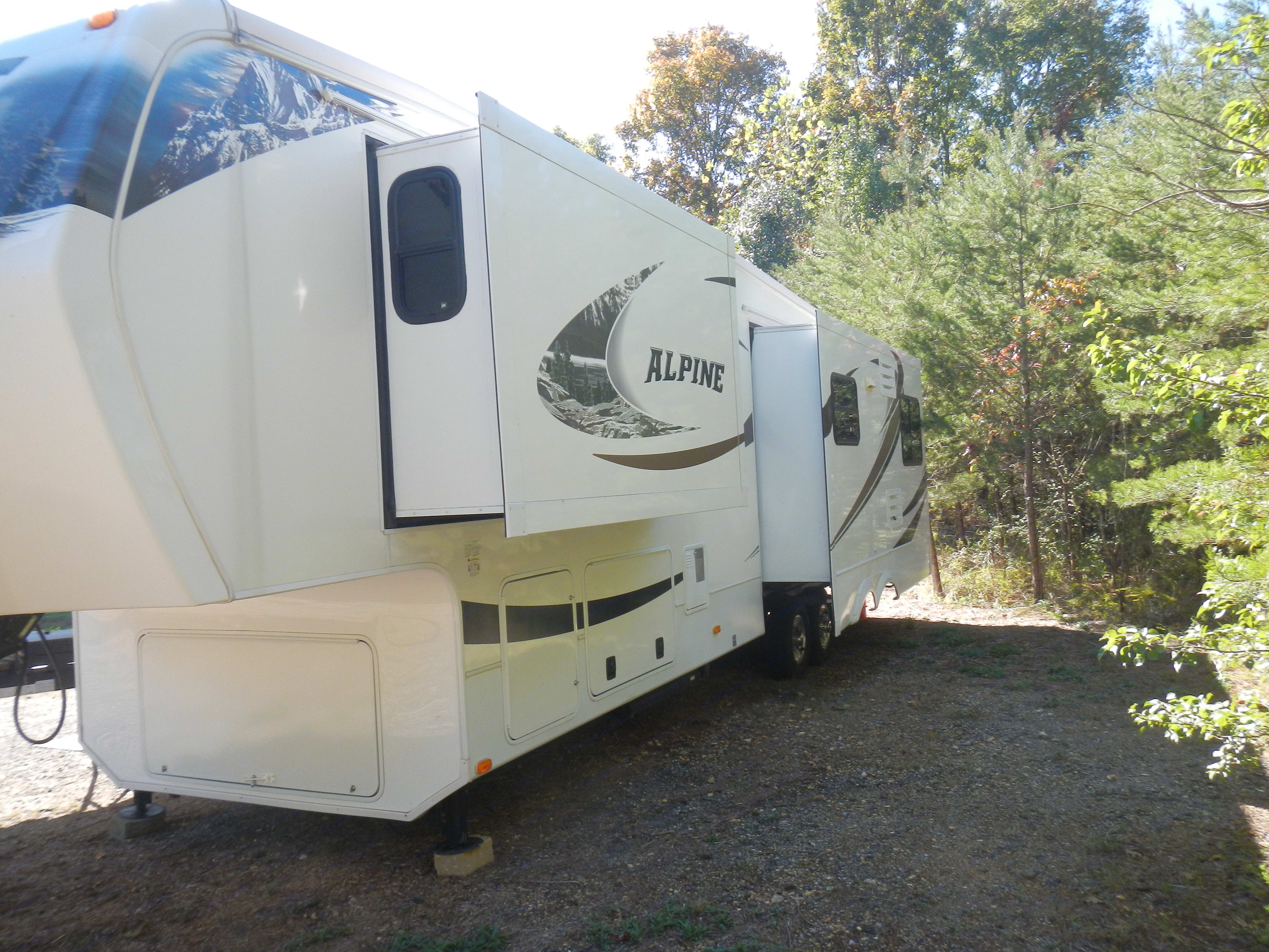 Exterior with slides extended.. Keystone Alpine 2011