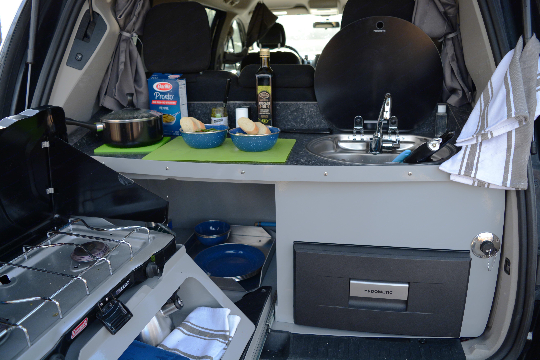 The kitchenette features a sink, 2-burner stove and fridge.. Dodge Grand Caravan 2016