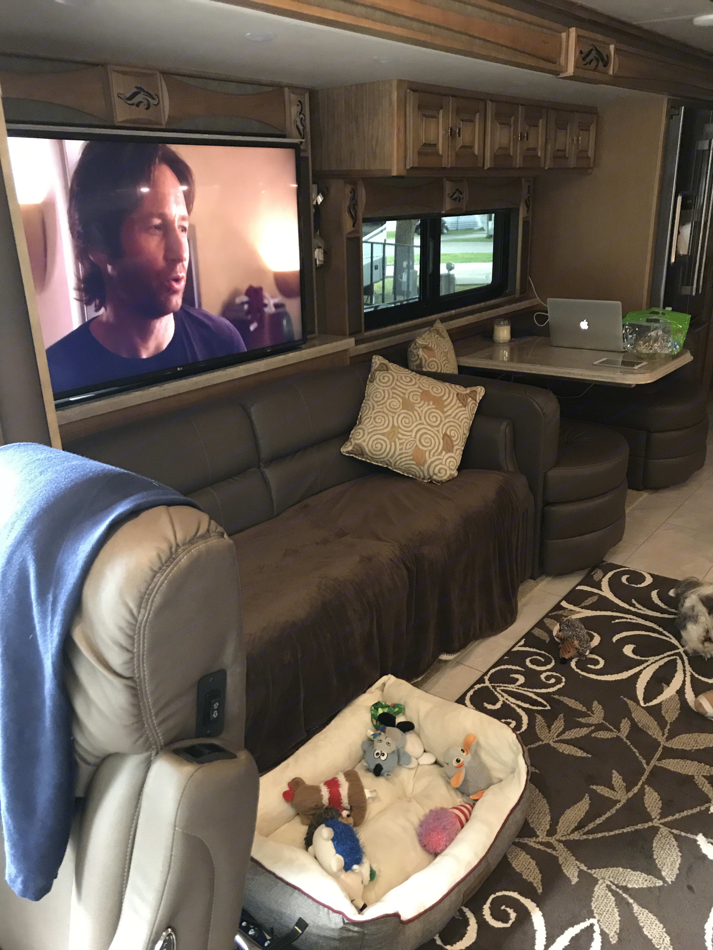 4 Large TV's in Den, Bedroom, Outside and above Driver seat couch opens up to a bed. Tiffin Motorhomes Phaeton 2018