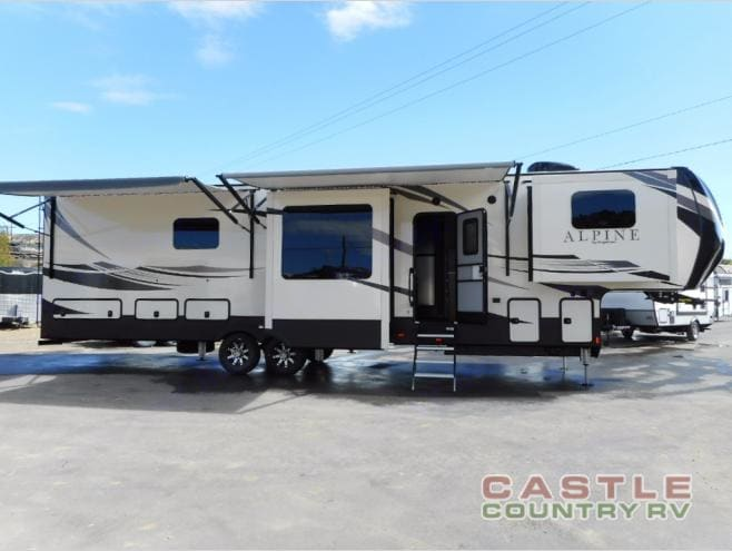Right Side with Awnings out. Keystone Alpine 2018