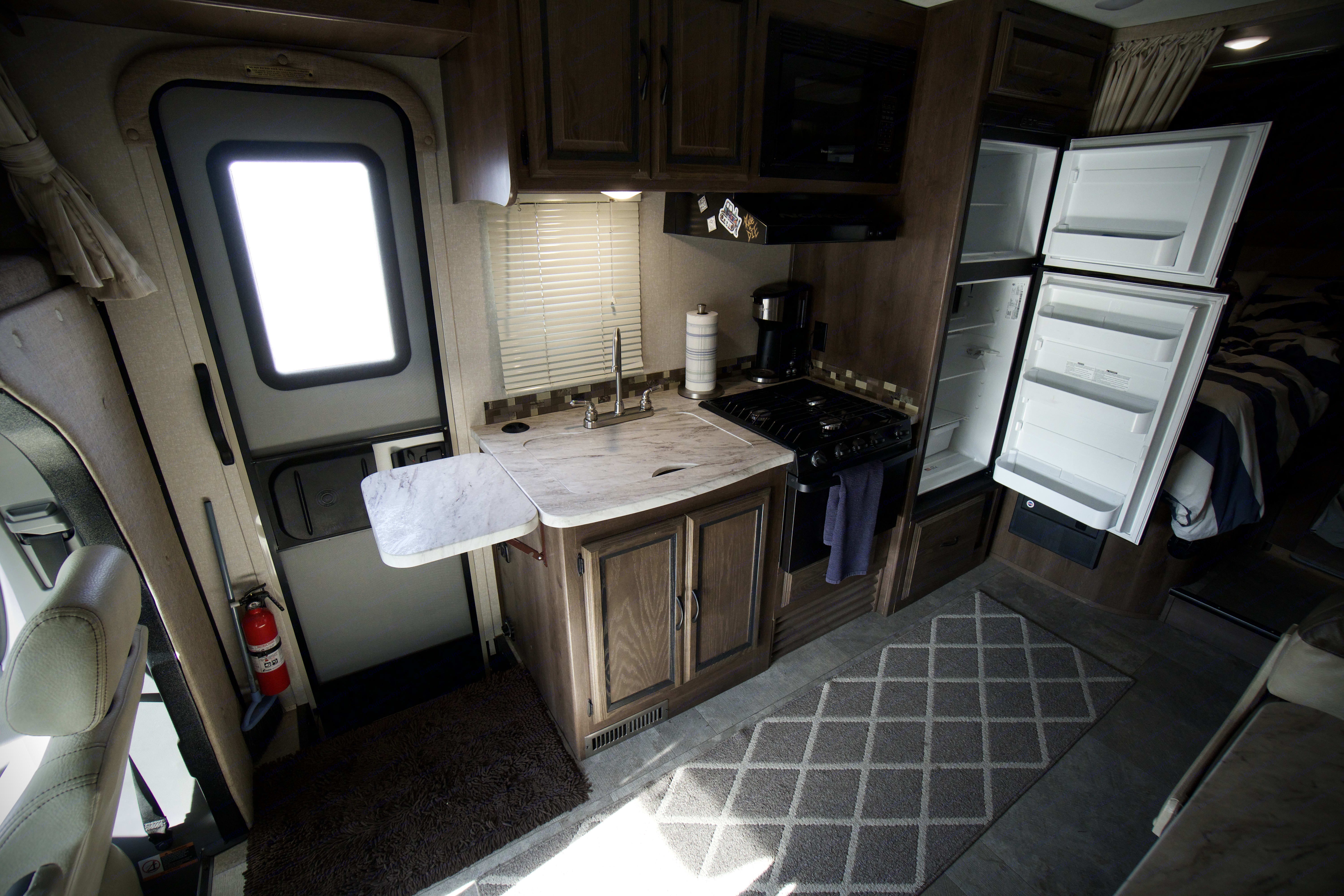 The kitchen has a three burner stove, an oven and microwave for all your cooking needs. . Coachmen Prism 2018