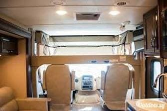Overhead bunk lowered. Thor Motor Coach Axis 2018