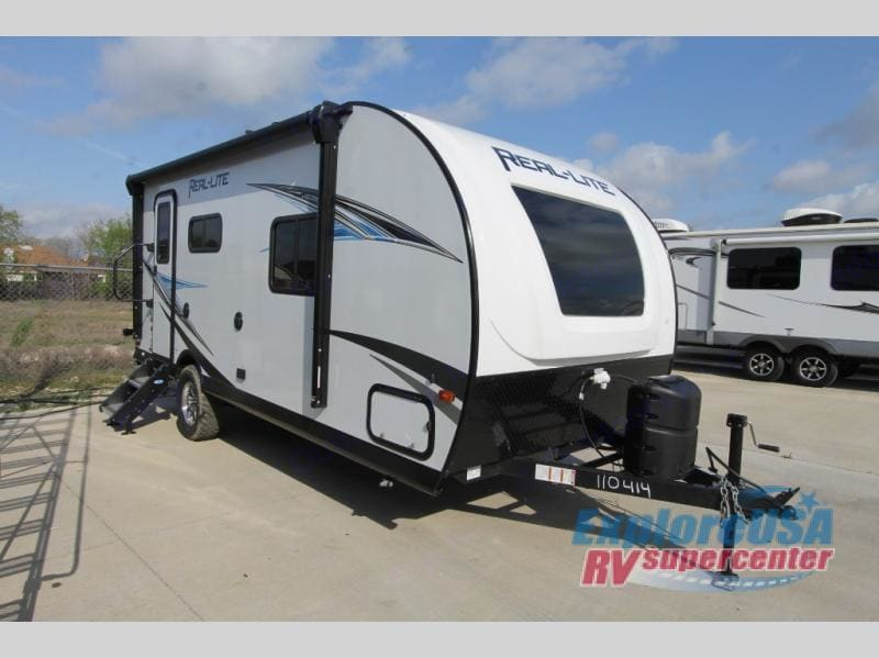 The camper is basically brand new and has only been used twice. This was taken by the dealer, but it still looks the exact same.. Palomino Real-Lite 2019