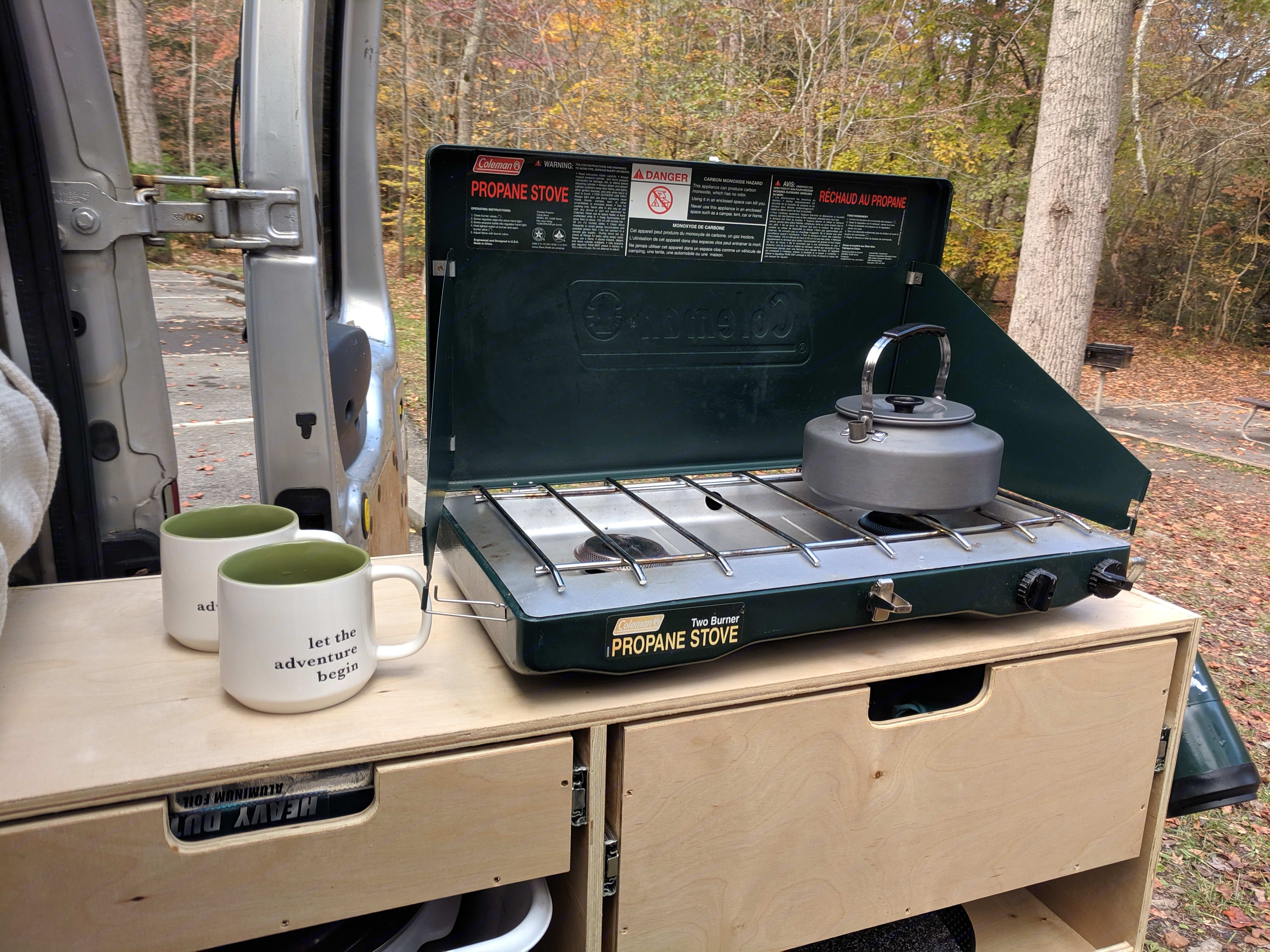 2-burner Coleman propane stove plus countertop drawer; work area + dry storage . Ford Transit Connect 2010