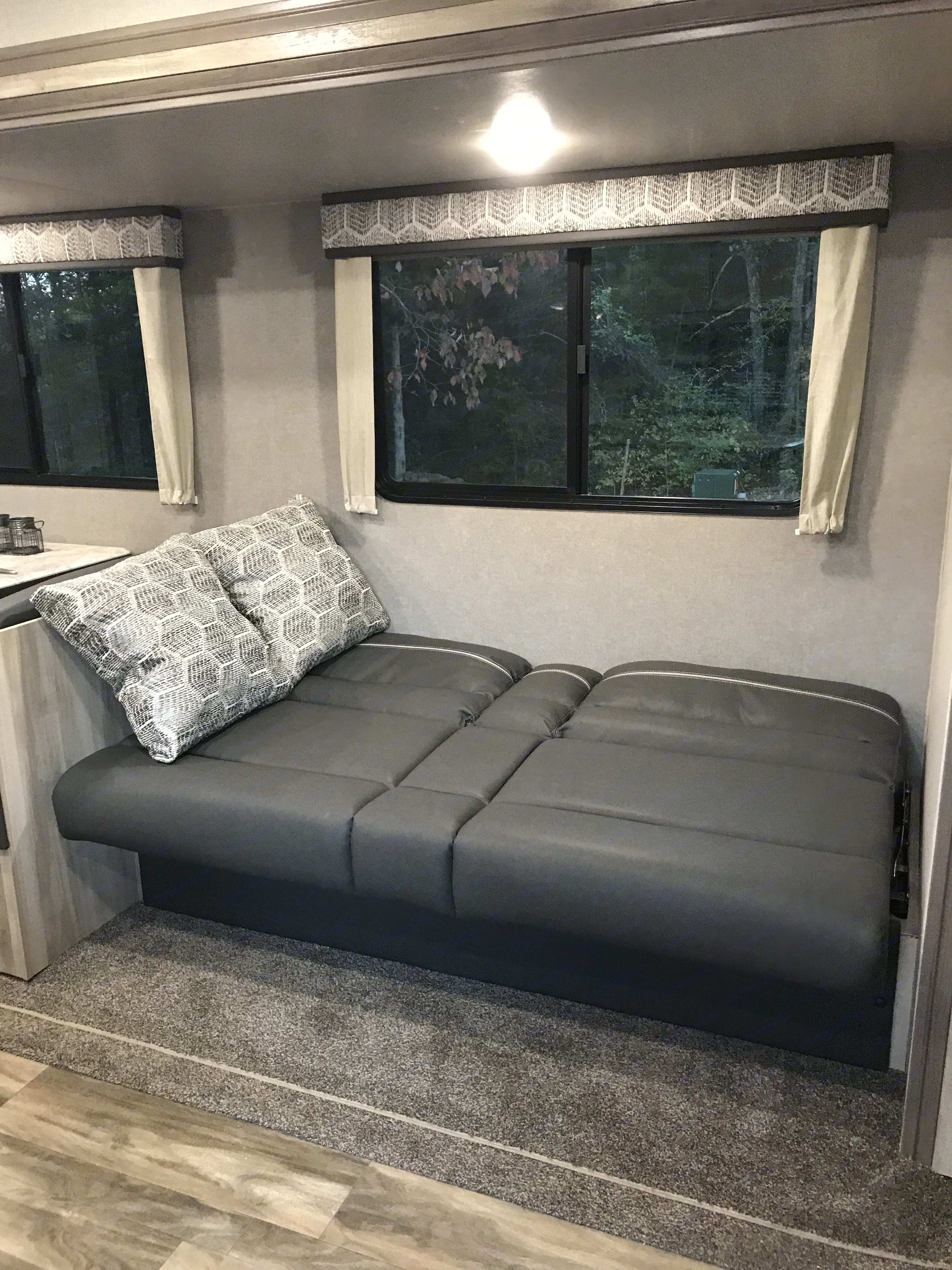 Couch folds down to make double bed. Coachmen Catalina 2020