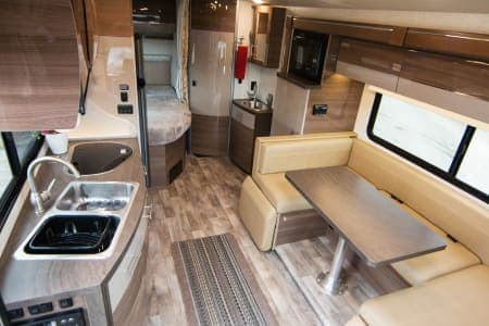 The dinette is amazing.  Easily seats 4 adults and has footstools that swing up for full reclining to view the tv.  Table is easily removed to covert into wrap-around couch or with a few more steps converted to a full size bed.  . Winnebago Mercedes Sprinter 2018