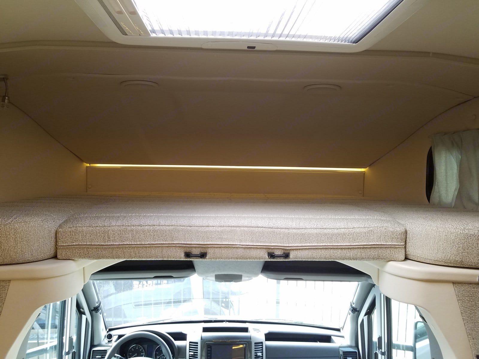Over the cab sleeping area accommodates a kiddo or 2 pretty easily.  Nice windows & a privacy curtain.. Winnebago Mercedes Sprinter 2018