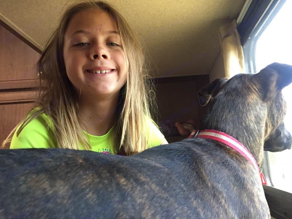 Our Daughter and her Dog Cooky on the top bunk in the back of the Travel Trailer. Shasta Oasis 2017