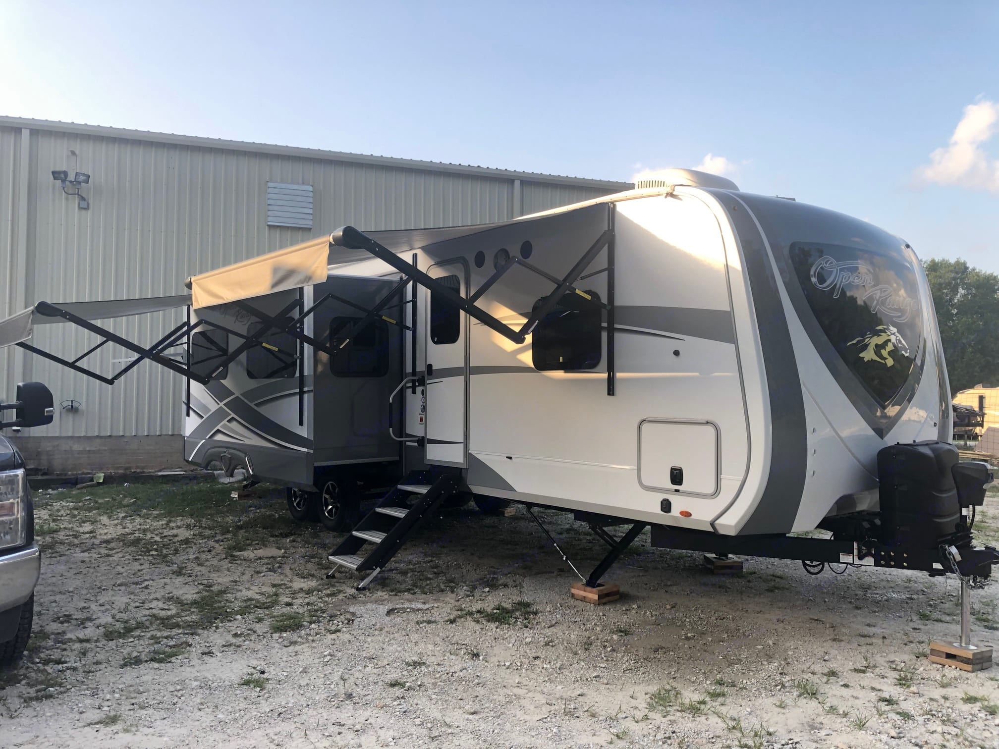 Exterior passenger side with one slide and awnings out.. Open Range Open Range 2019