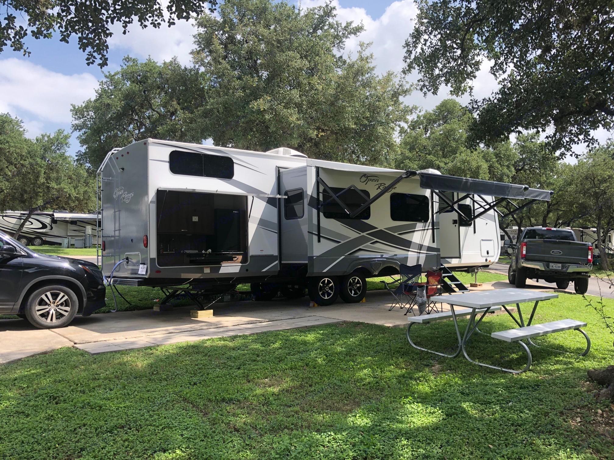 Exterior passenger side with outdoor kitchen opened up.. Open Range Open Range 2019