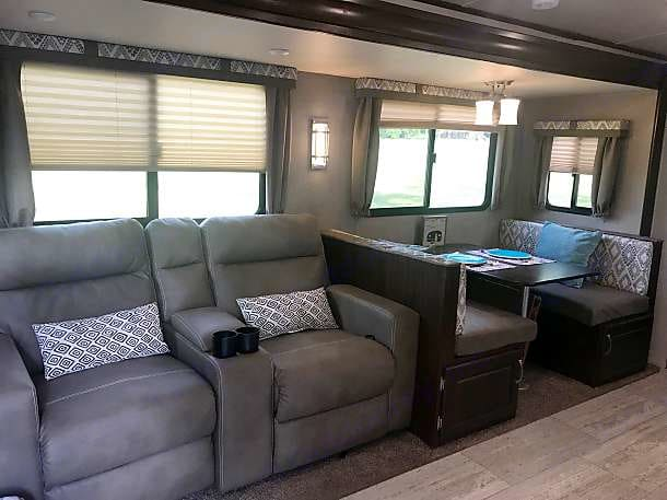 Reclining Theater seats and dinette that makes a bed. . Palomino Solaire Ultra Lite 2019