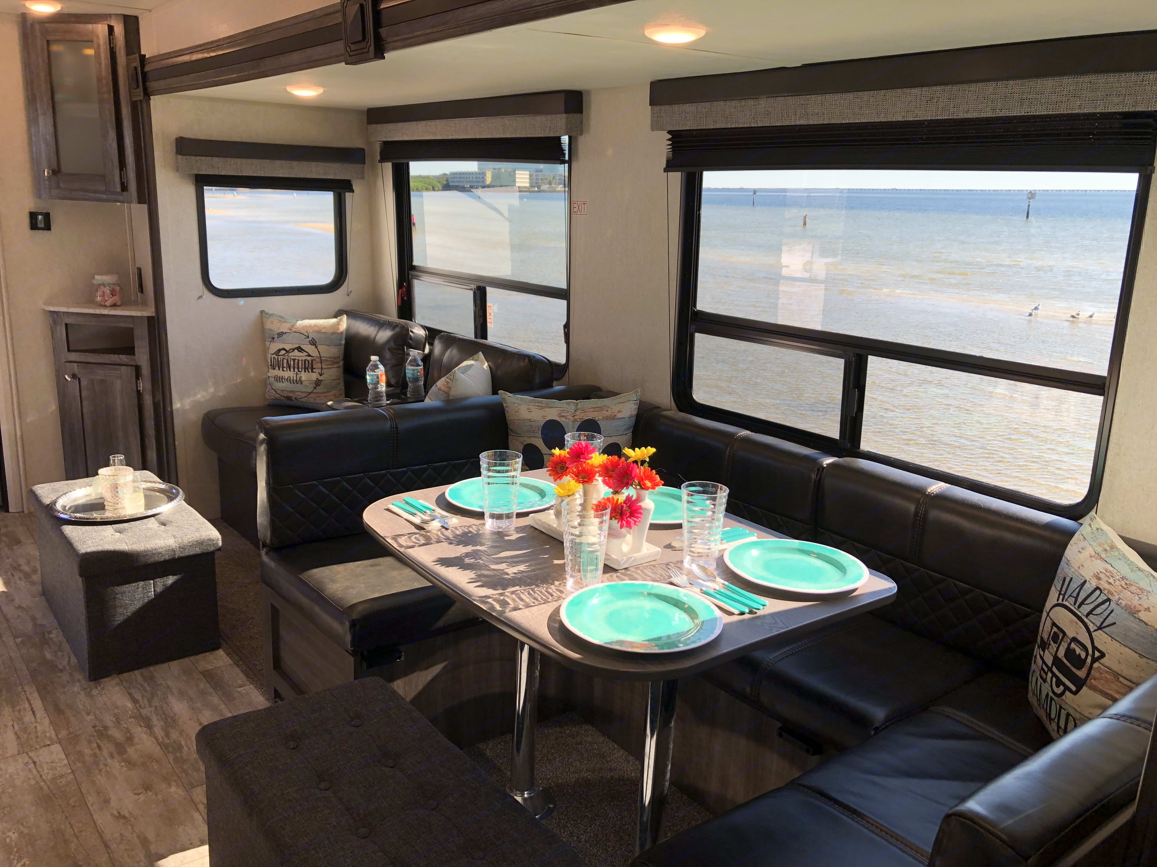 Full dinette with service for 8 plus the ottomans provide additional storage, seating or footrests!. Highland Ridge Open Range 282BH 2019