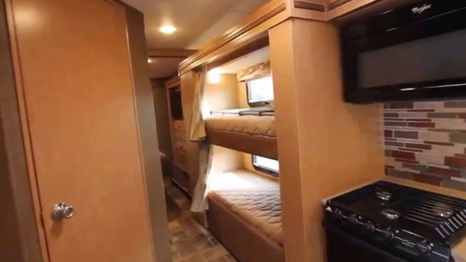 Bunk Beds with individual TV's in each bunk with built in DVD's in each TV and Remotes and a curtain to close off each bunk bed.. Thor Motor Coach Chateau Bunk House 2018