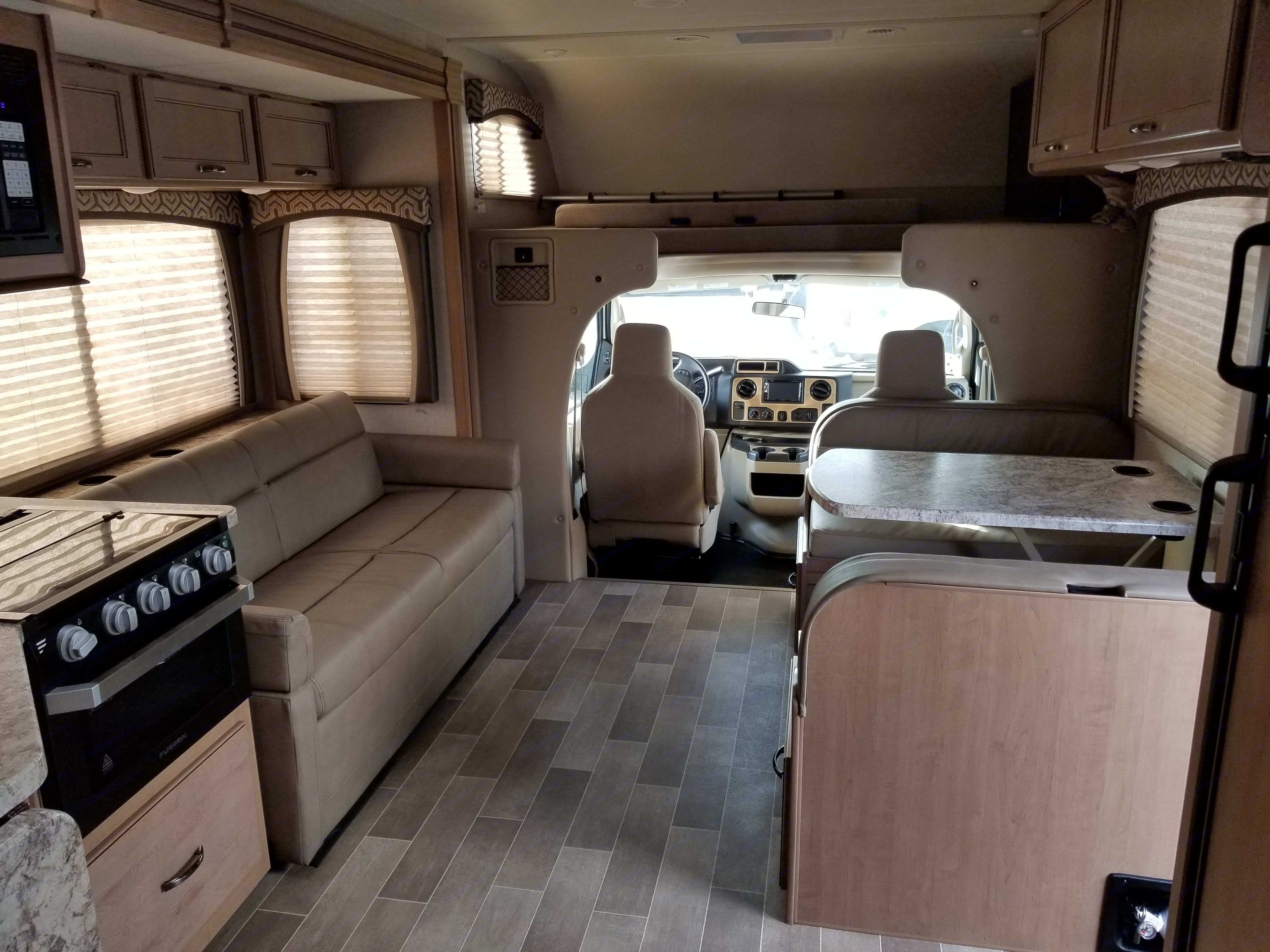 Roomy living space for extended family vacations. Couch across from dinette are great for hanging out. Swing out TV in overhead bunk if it's raining or cold out.  . Thor Motor Coach Chateau 2020