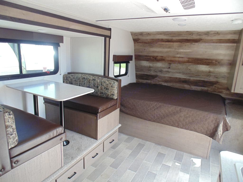 Queen bed and dining table (looking at front). Keystone Hideout 2020