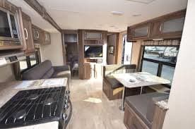 Kitchen table makes into a bed. Coachmen Apex 2017