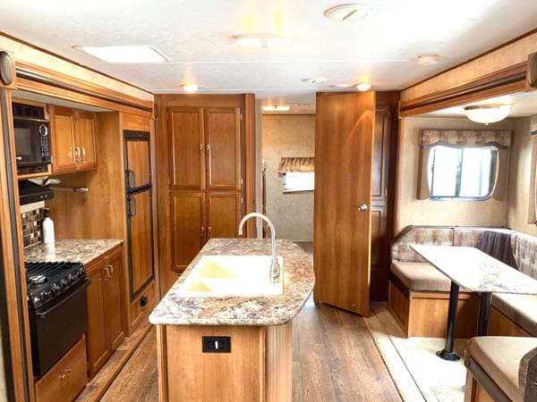 Island Kitchen with Kitchen and Dinette looking into rear bedroom and pantry. Prime Time Avenger Touring Edition 32BIT 2015
