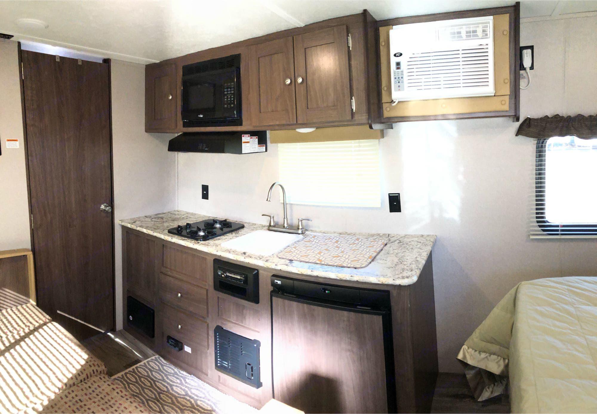 Kitchen Area, 2 stovetop burners + small fridge/freezer.. Keystone Hideout 2019