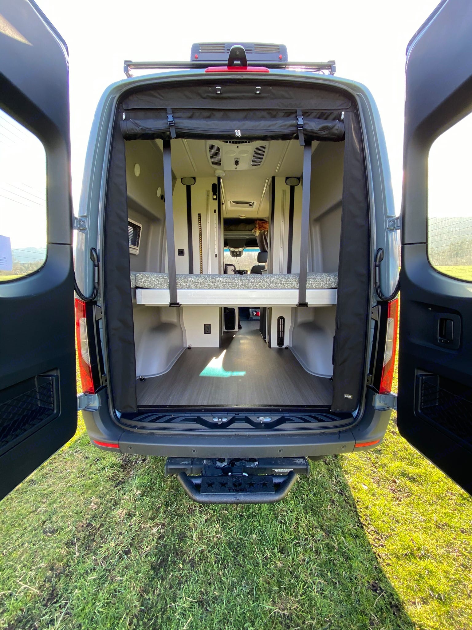 Bed lifts up and down to allow for more storage in the back while driving.. Winnebago Mercedes Sprinter 2020