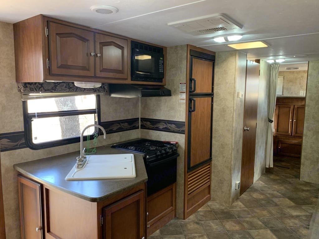 Kitchen area and is fully stocked. Keystone Passport Ultra Lite Grand Touring 2910BH 2012
