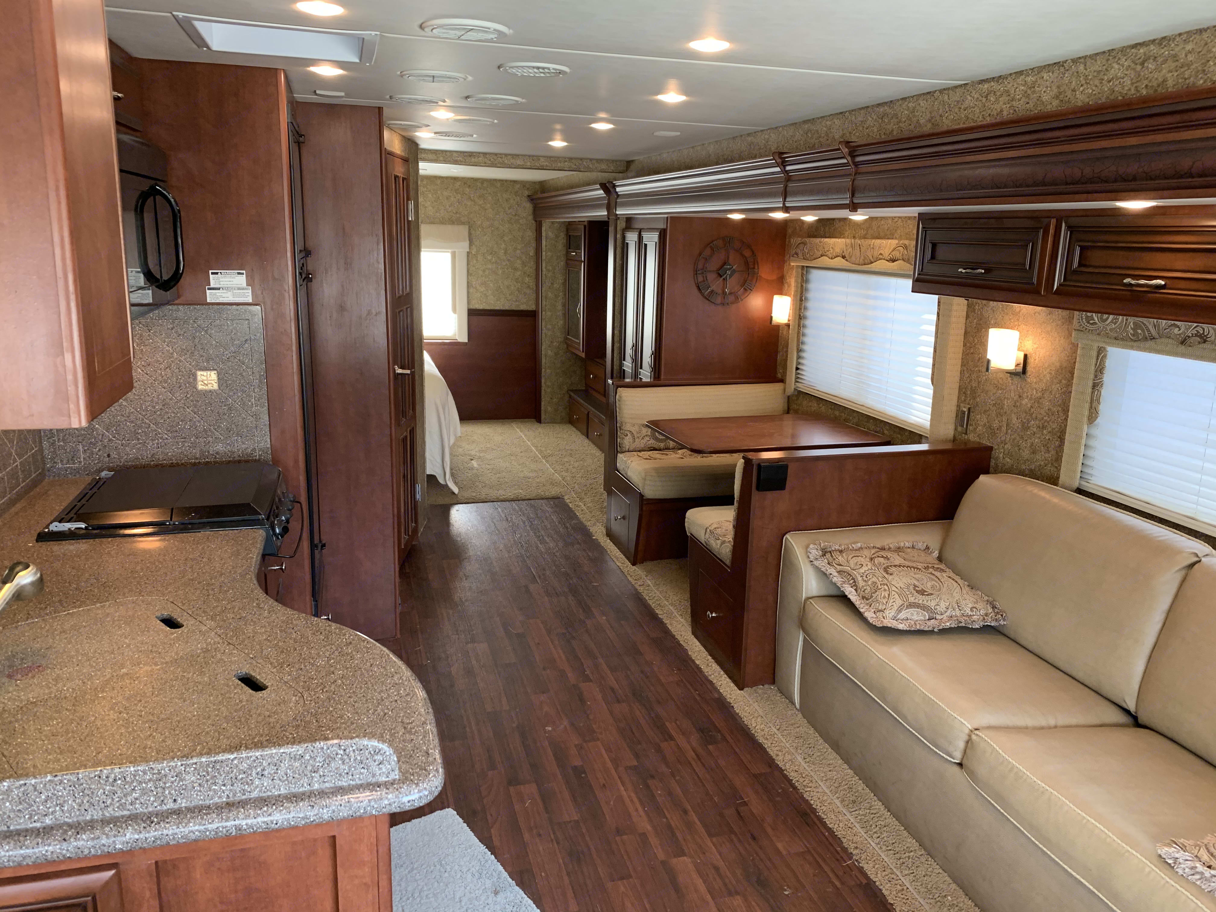 "entry looking toward the rear.  dining table folds down and converts area to a 69"" x 37"" bed (children). Newmar Bay Star 2014"