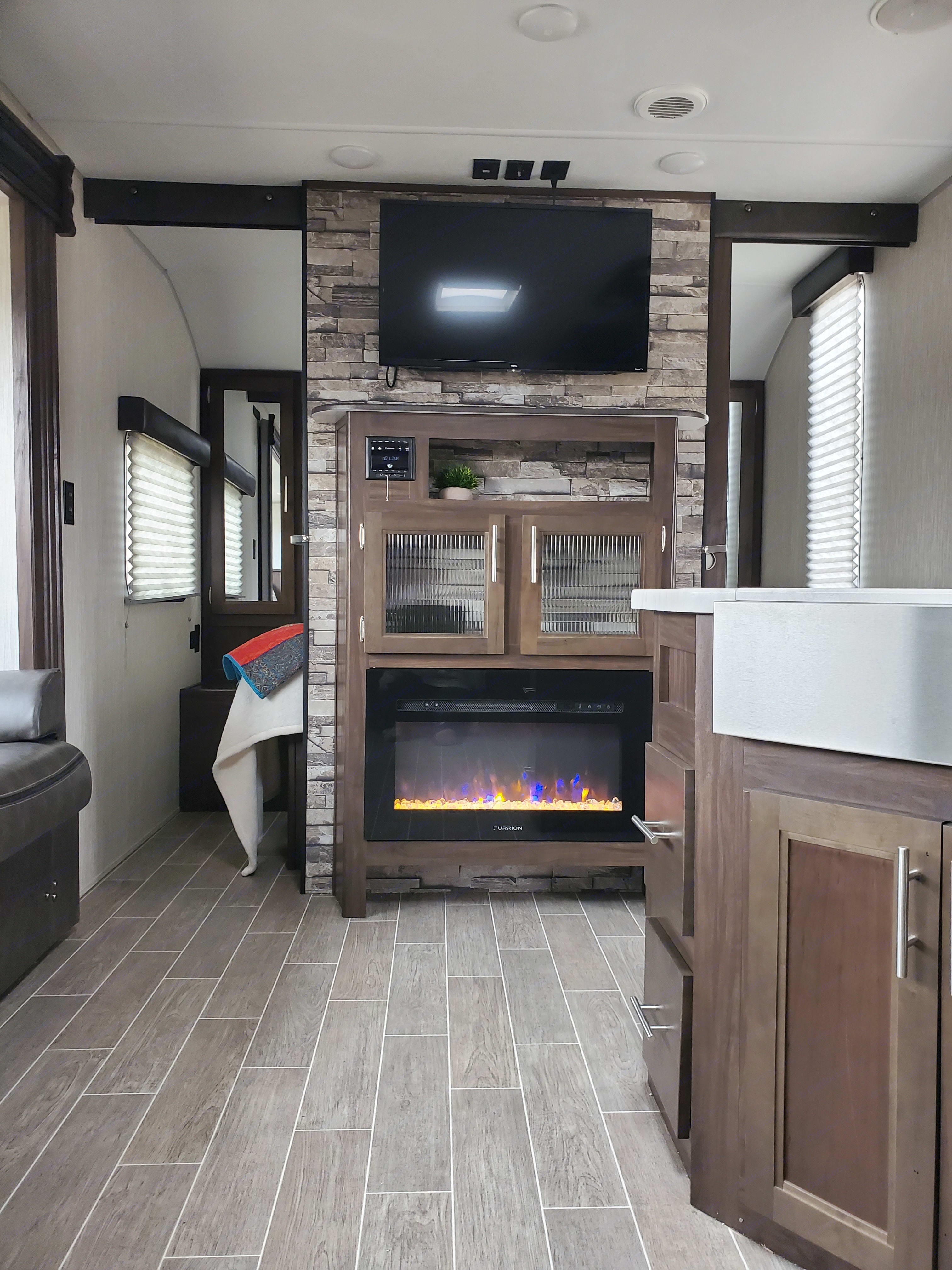 Set the fire for ambience or turn on the heat also! We also have a furnace that runs through out the trailer. . Forest River Cherokee Grey Wolf 2020