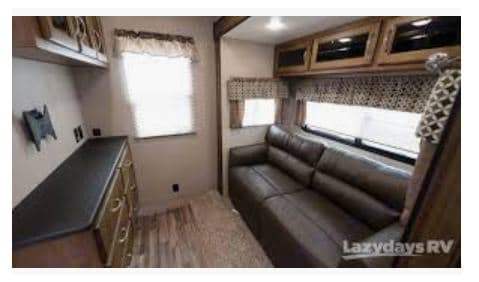 Second Bedroom with fold out couch.. Coachmen Chaparral 2019