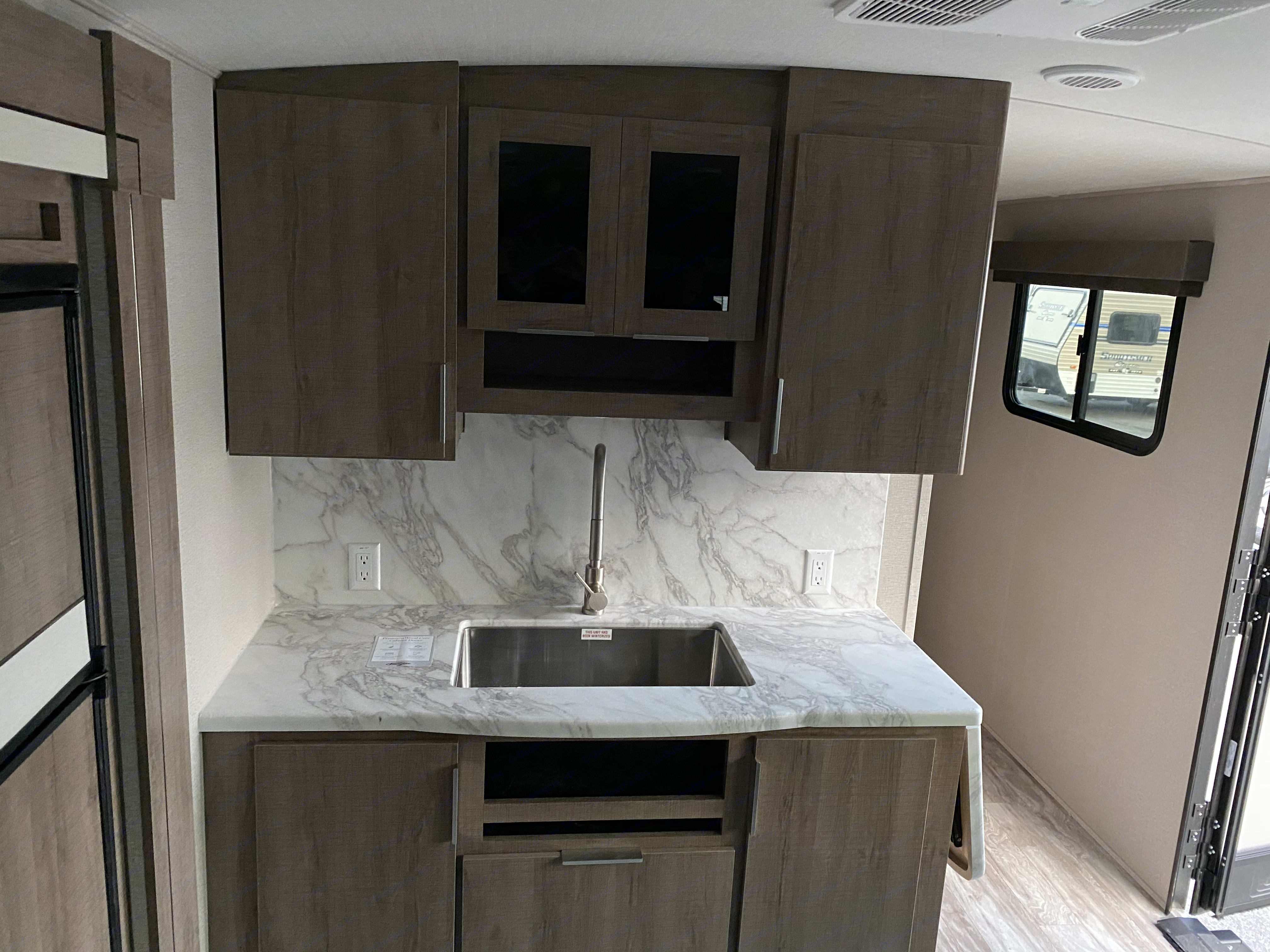 Kitchen w/ full size residential sink. Grand Design Imagine 3100RD 2020