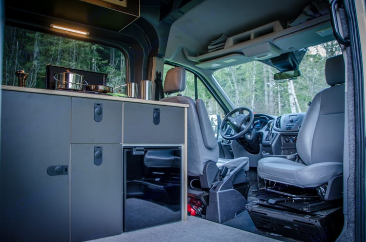 Front swivel seats turns the van into a great hang out spot.. Ford Transit 2017