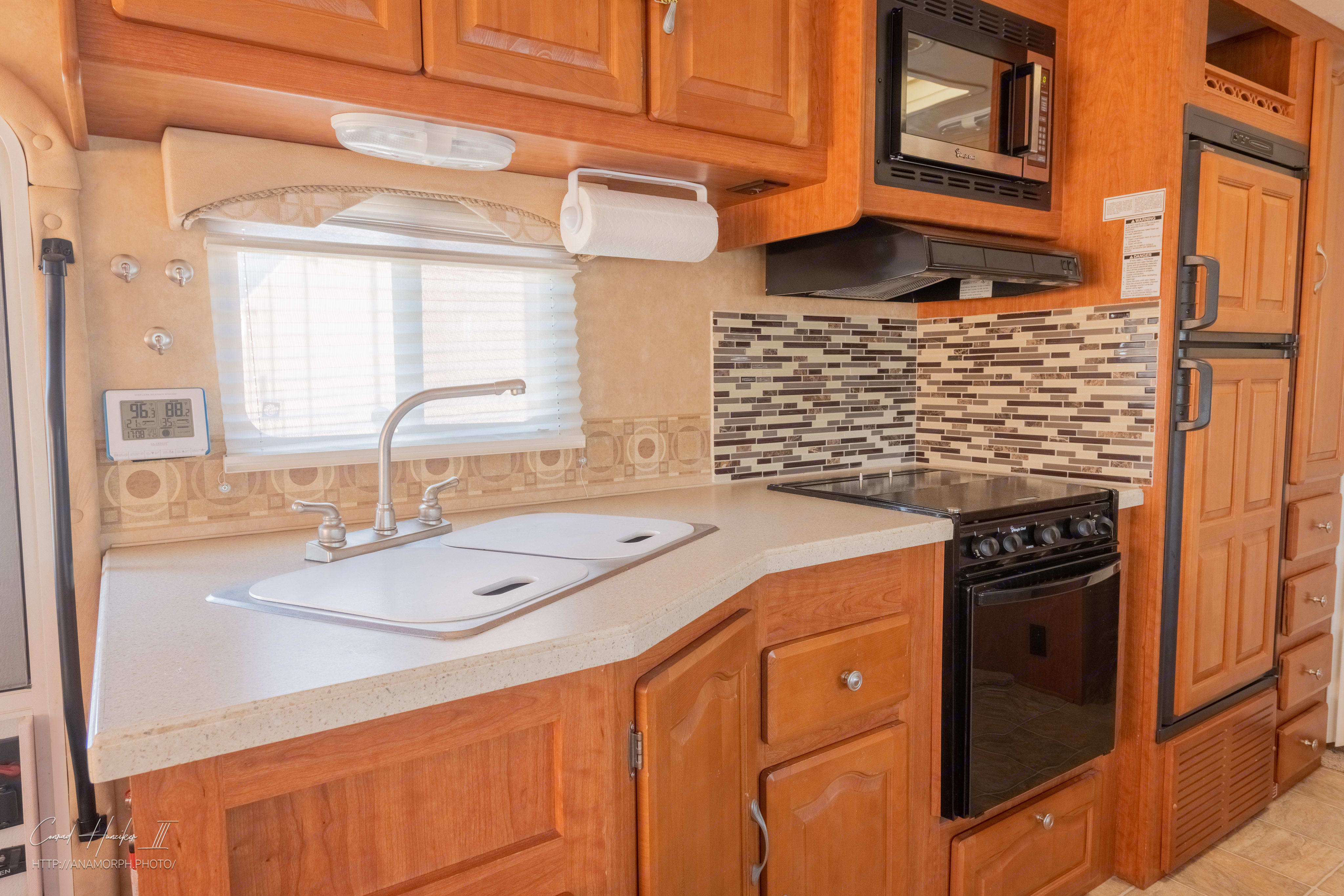 Kitchen, with dual sinks, oven, stove and microwave. Also comes with pots, pans and utensils!. Forest River Georgetown 2008