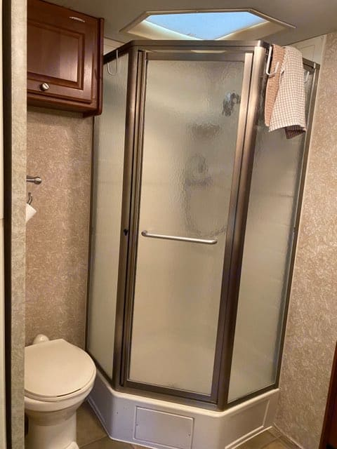 Shower has Electric or Gas hot water (Instant and endless hot water). Thor Motor Coach Windsport 2006