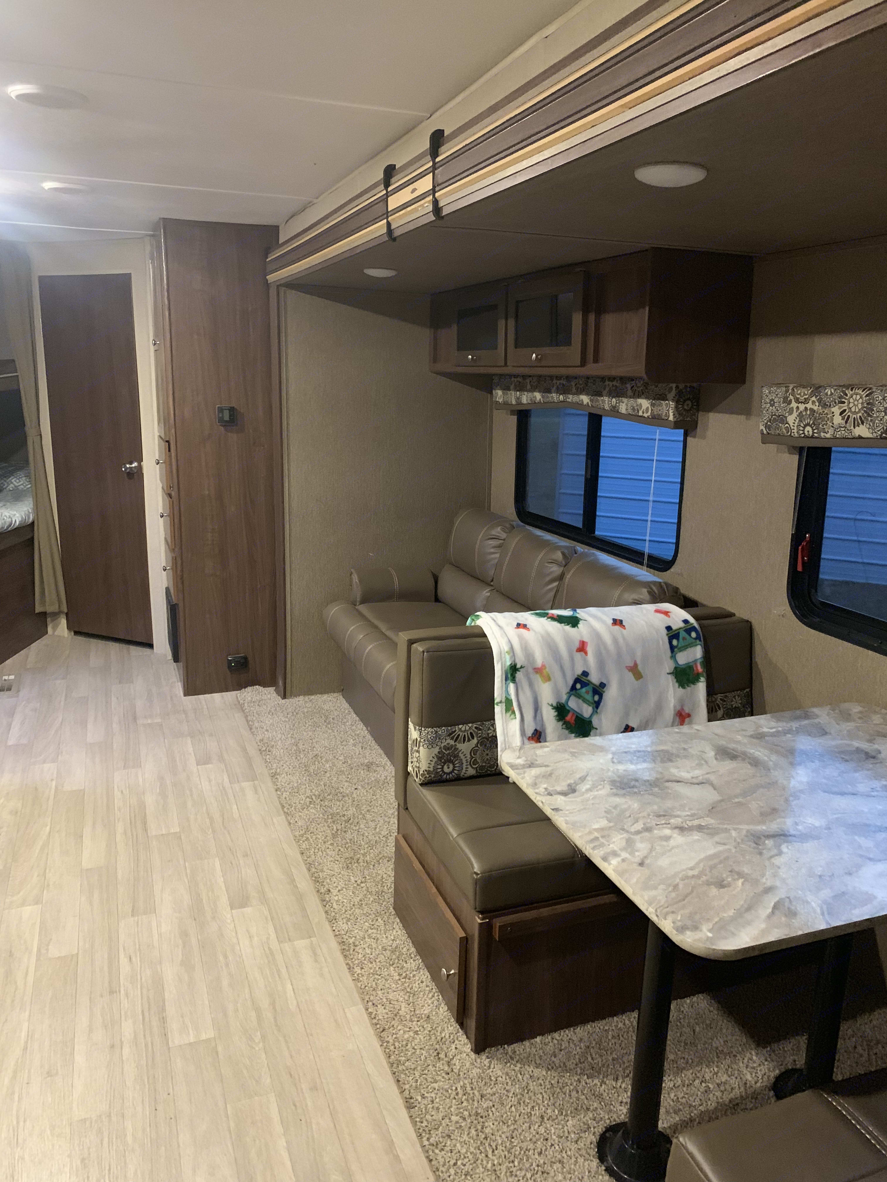Dining table and couch- cabin area. Coleman Lantern Edition 2018