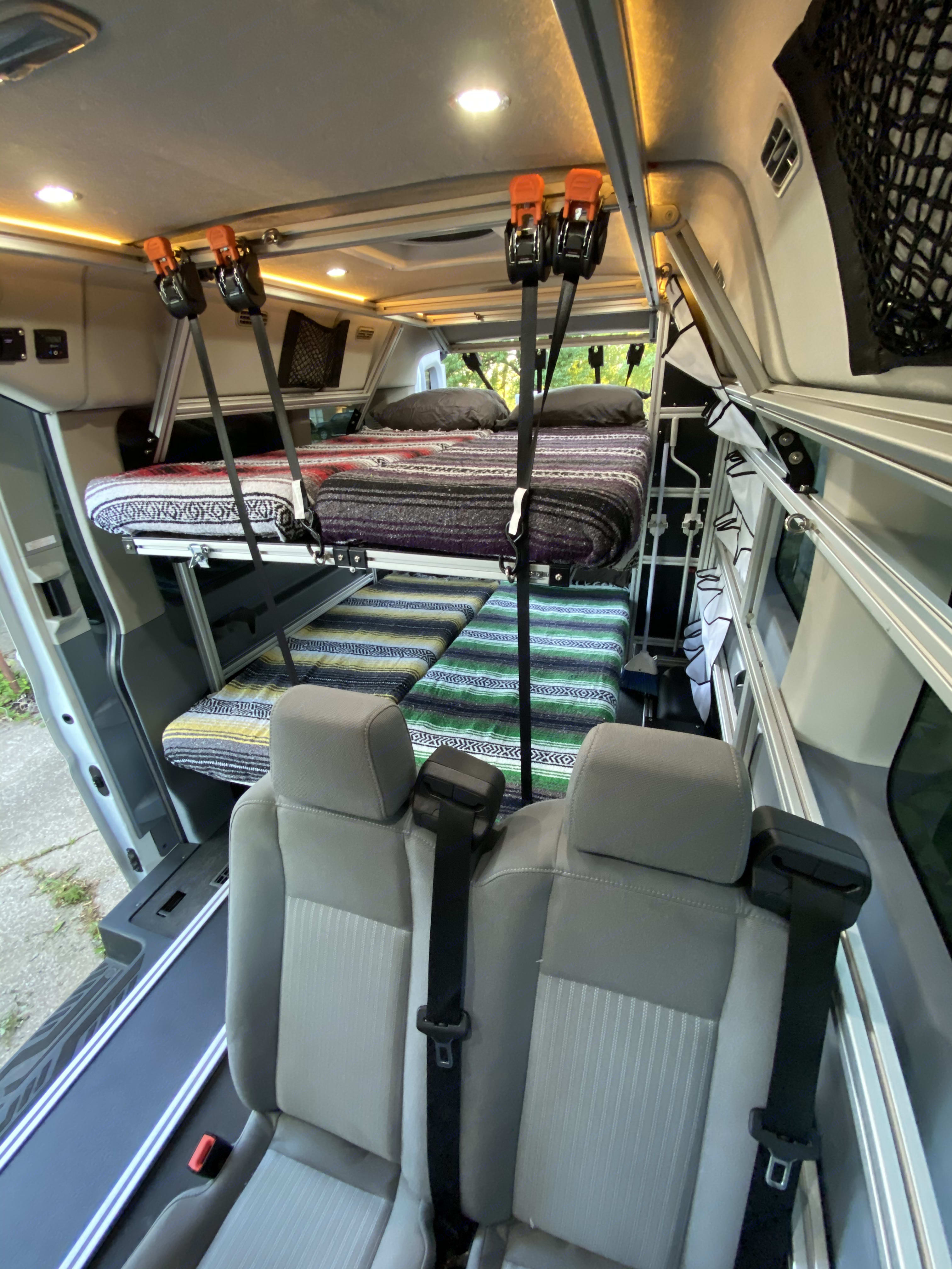 A view from the inside of the beds set up to sleep four. Don't tell me that this doesn't look like fun!. Ford Custom Transit VanDOit Adventure Van 2017