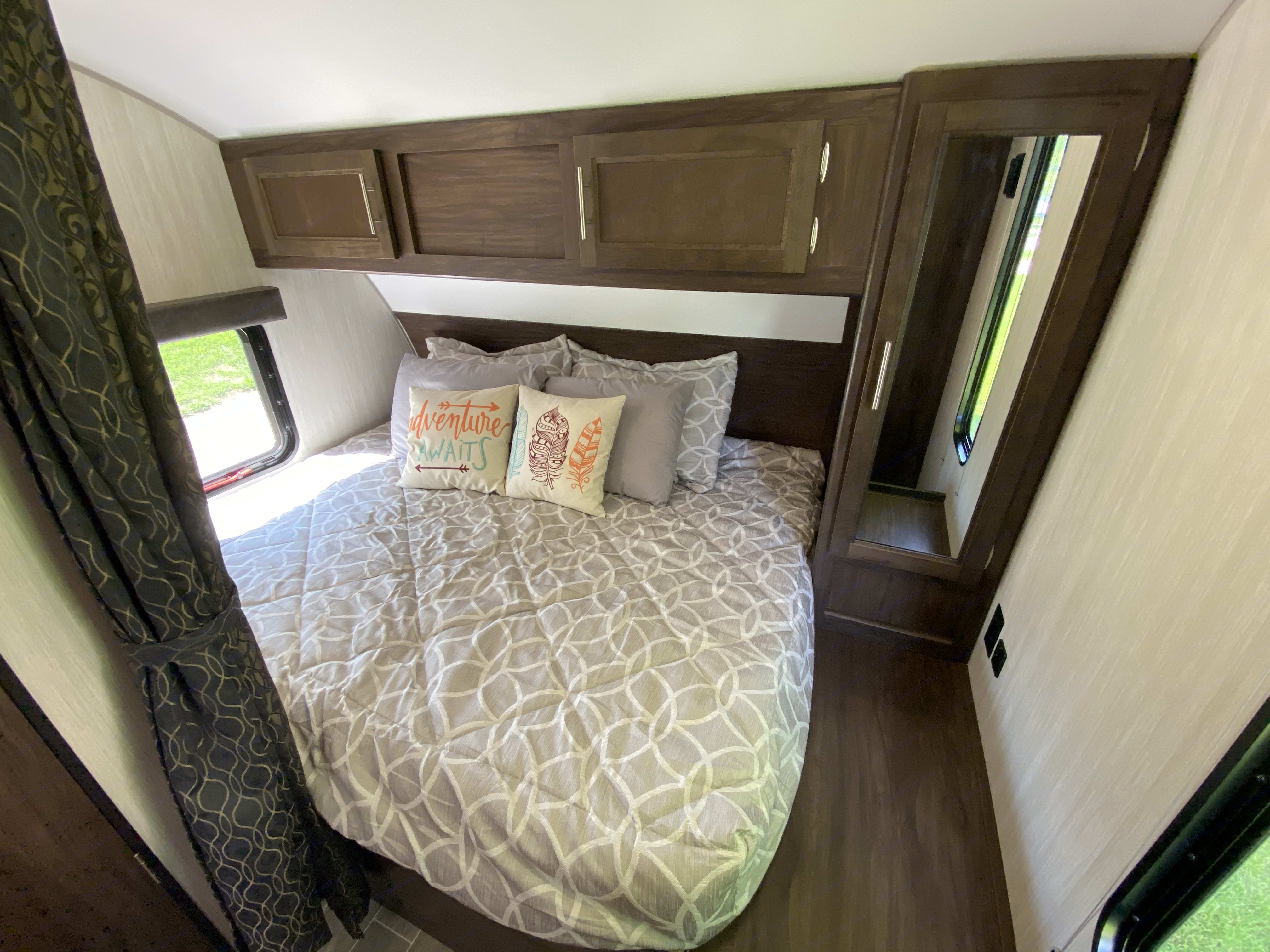 Queen bedroom with privacy curtain. Forest River Cherokee Grey Wolf 2020