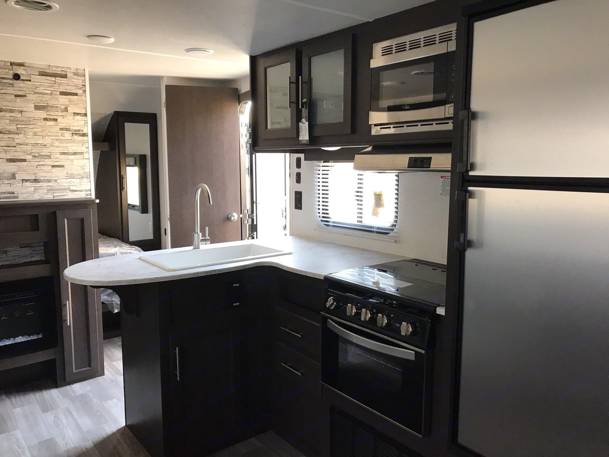 Interior kitchen. Forest River Wildwood X-Lite 2020
