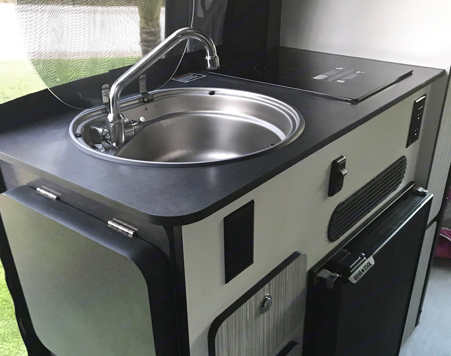 Galley with sink, stove top and fridge.. Mercedes Sprinter 2020