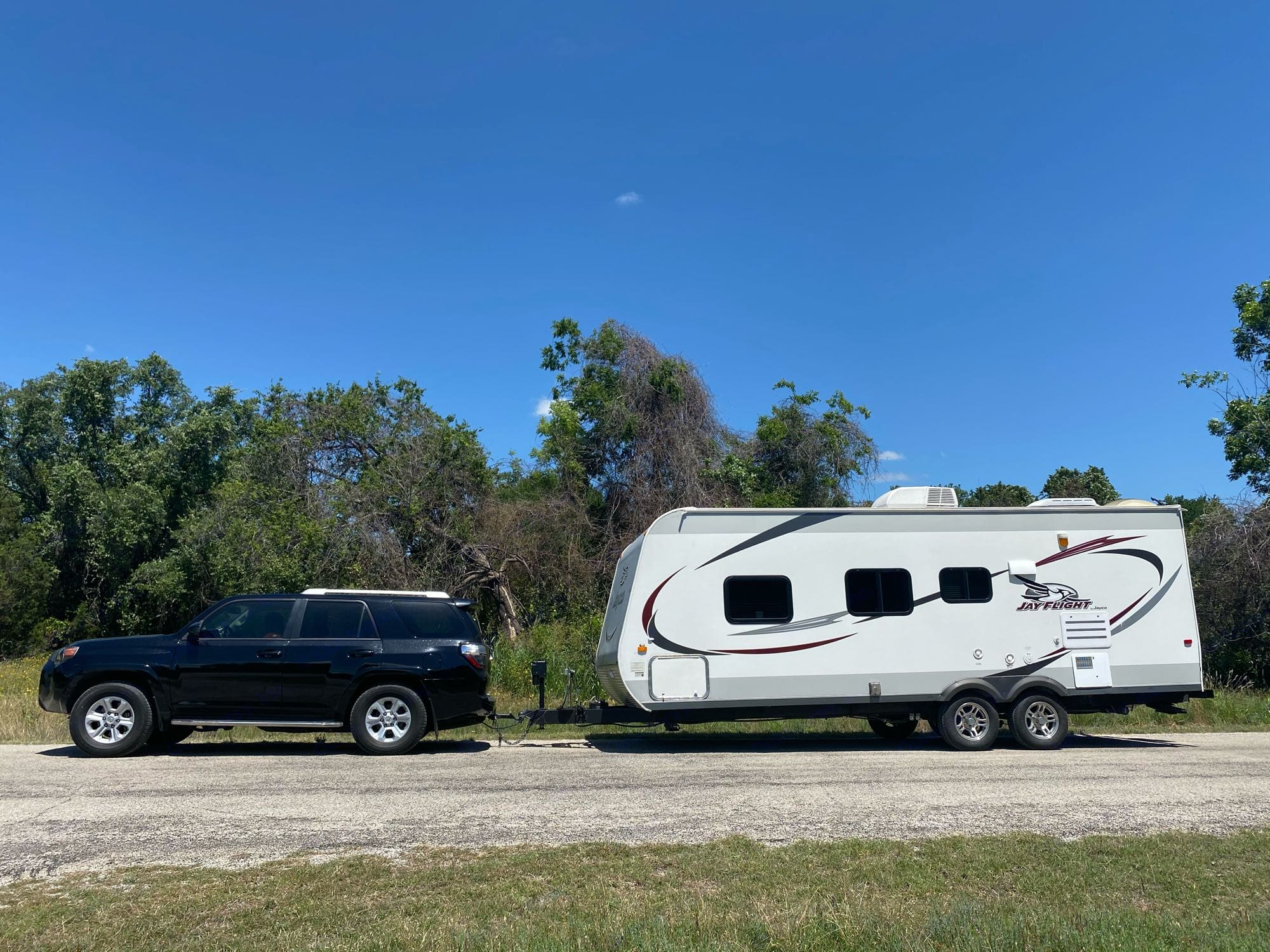 At just under 5000 pounds our Jayflight can tow behind many midsized SUVs. Check your owners manual for towing capacity.. Jayco Jay Flight 2014