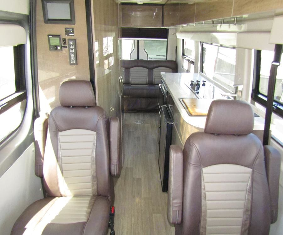 Second row of captain's chairs, right behind the driver's seat area.. Winnebago Era 2019