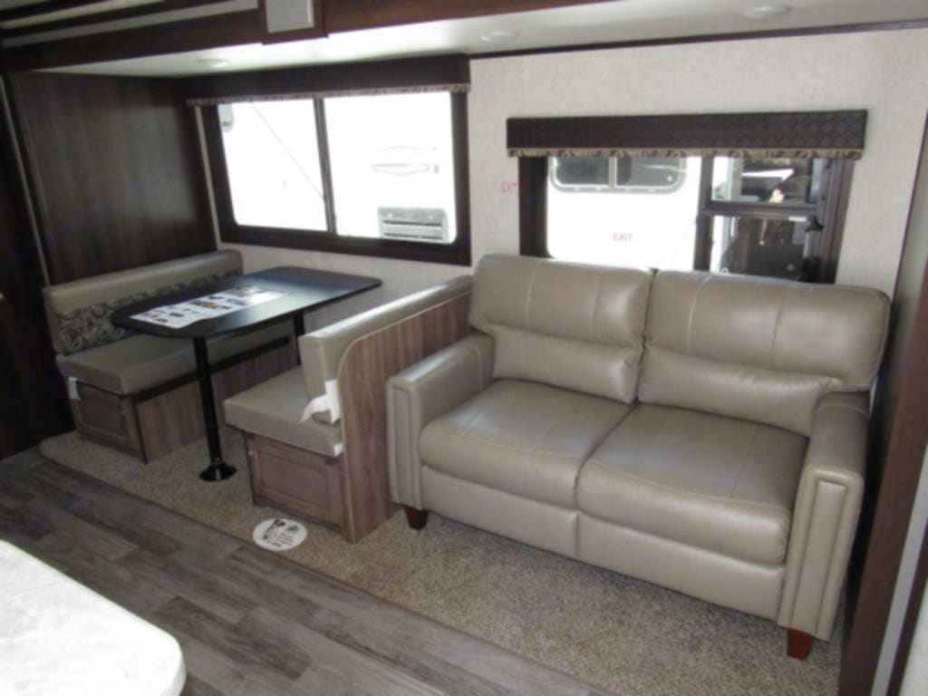Dinette seats 4 comfortably. Leather couch gives nice space to relax. Both collapse for additional sleeping.. Jayco Jay Feather 2019