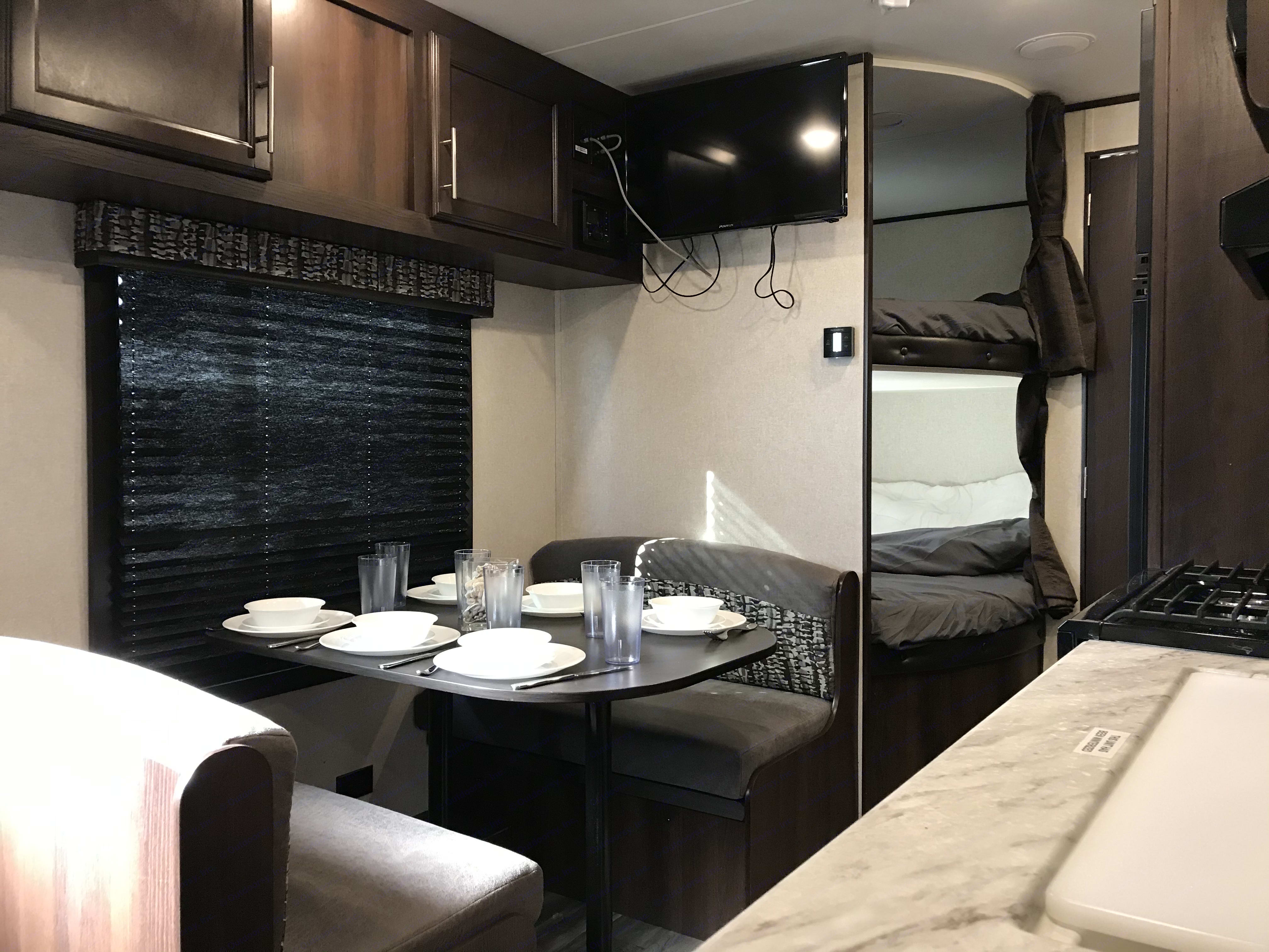 A pic of the dining area and bunks. Jayco Jay Flight 2020