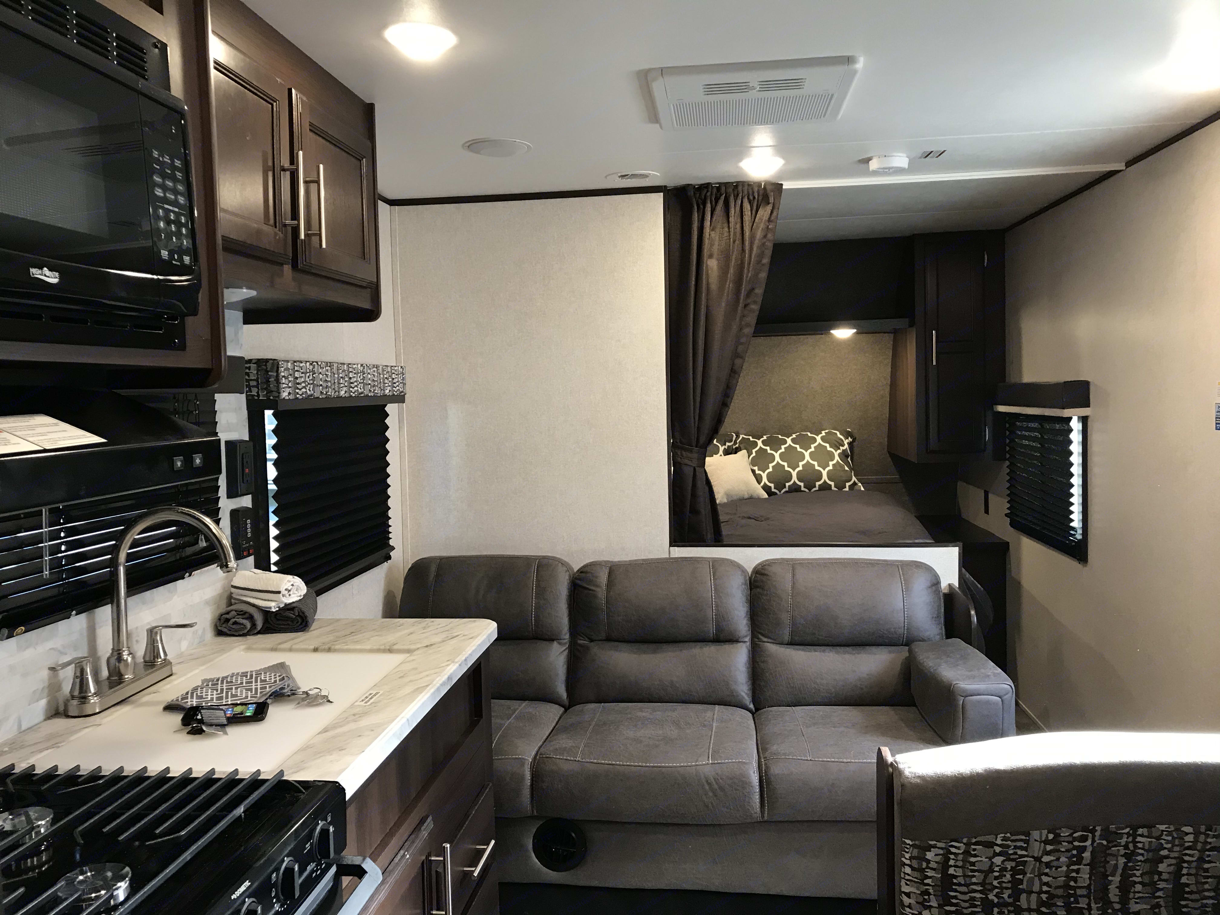 The lounge area off the kitchen with the peak of the separated Queen master bedroom.. Jayco Jay Flight 2020